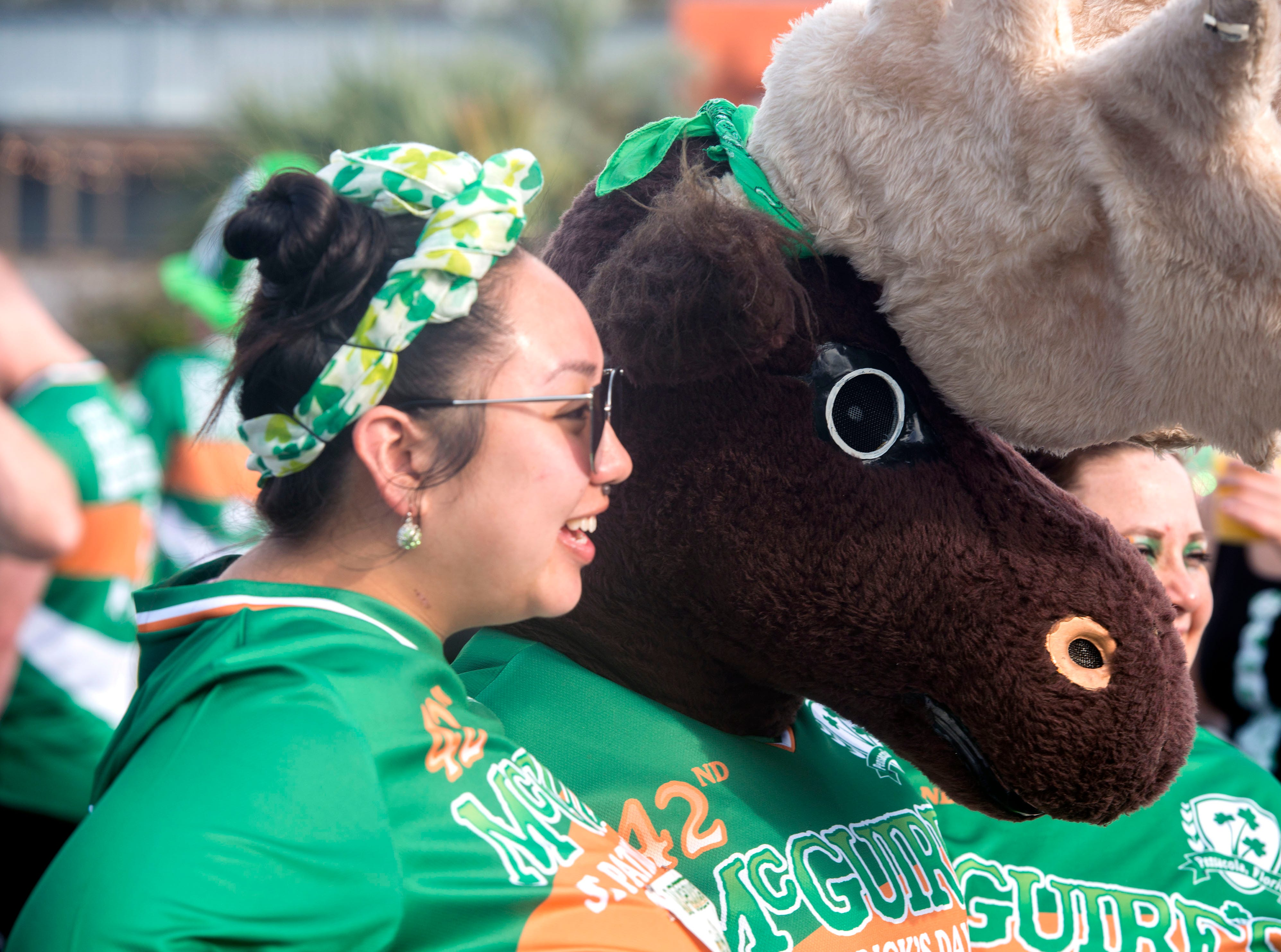 Runners participate in the 42nd annual McGuire's St. Patrick's Day Run Saturday, March 9, 2019.