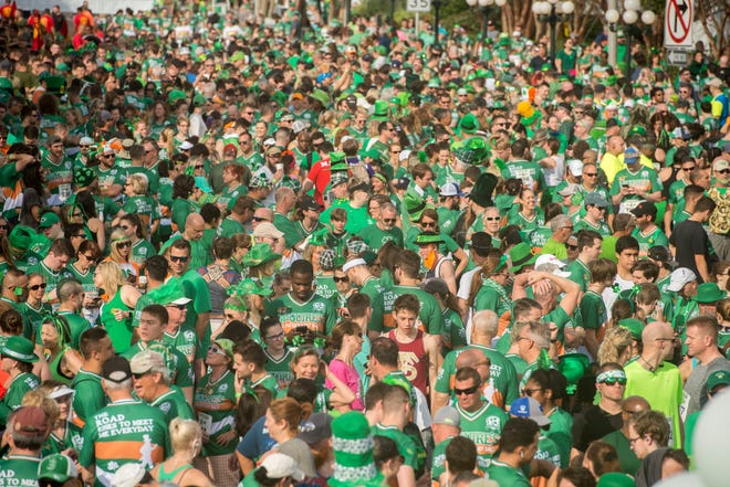 Runners participate in the 42nd annual McGuire's St. Patrick's Day Run last year. This year's festivities get underway on Saturday.