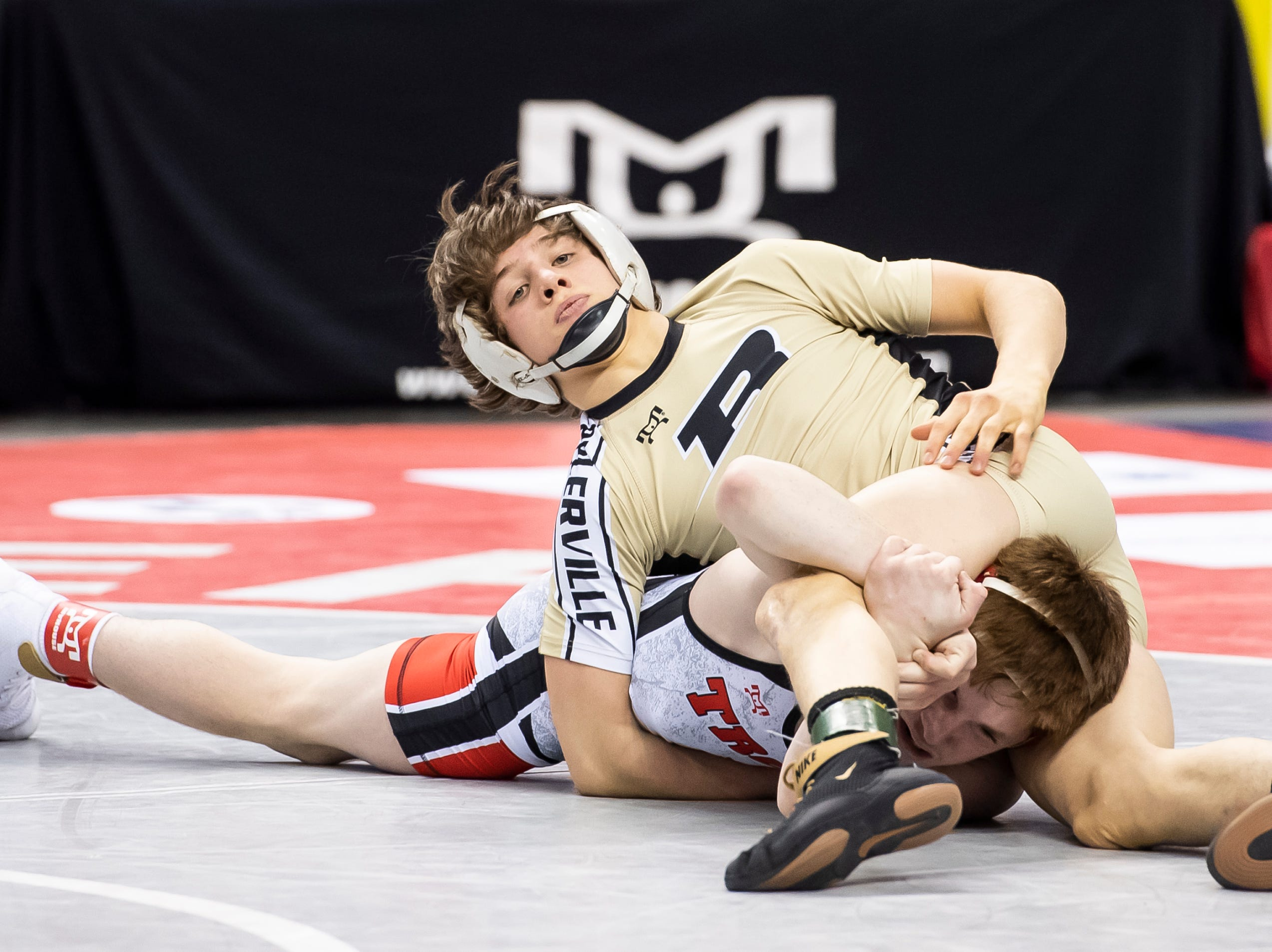Biglerville's Levi Haines, top, wrestles Troy Area's Sheldon Seymour during the PIAA 2A 106-pound championship bout at the Giant Center in Hershey Saturday, March 9, 2019. Seymour won 5-4.