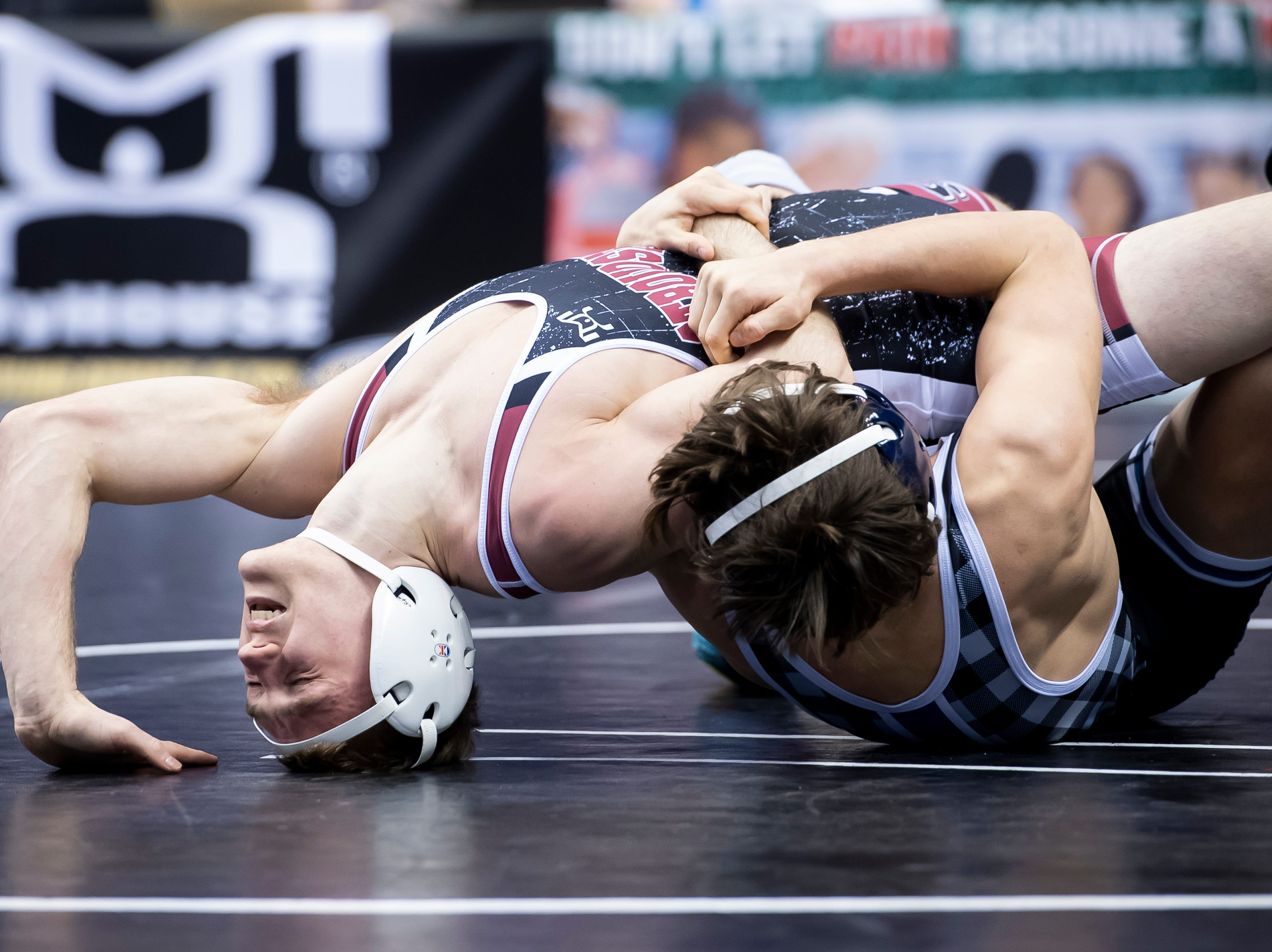 Chambersburg's Cole Grove, bottom, wrestles East Stroudsburg's Patrick Noonan during a 3A 126-pound second round consolation bout at the Giant Center in Hershey Friday, March 8, 2019. Grove won by major decision 13-4.