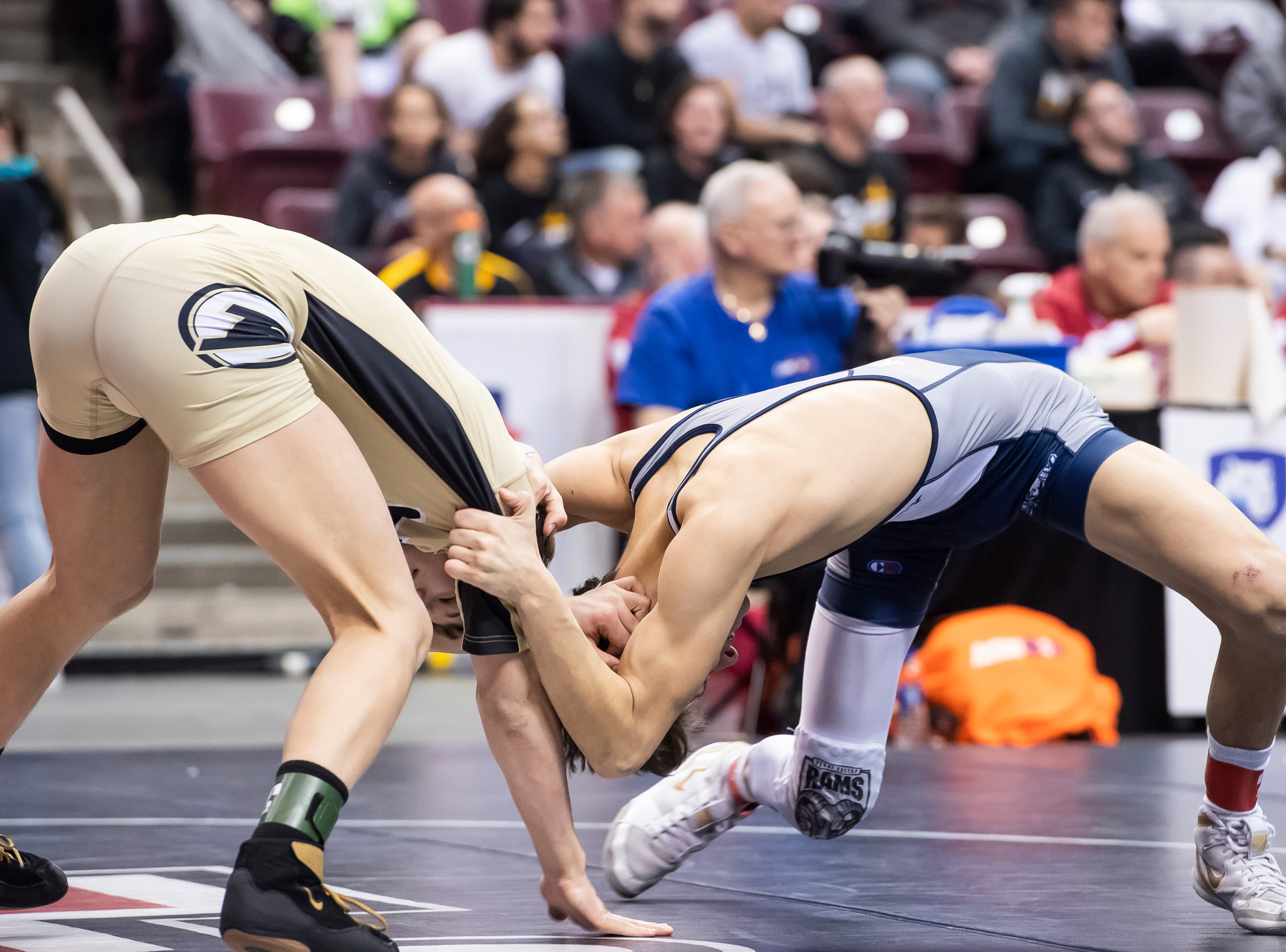 Biglerville's Blake Showers, left, wrestles Penns Valley's Baylor Shunk during the PIAA 2A 120-pound 7th-place bout at the Giant Center in Hershey Saturday, March 9, 2019. Shunk won 10-5.