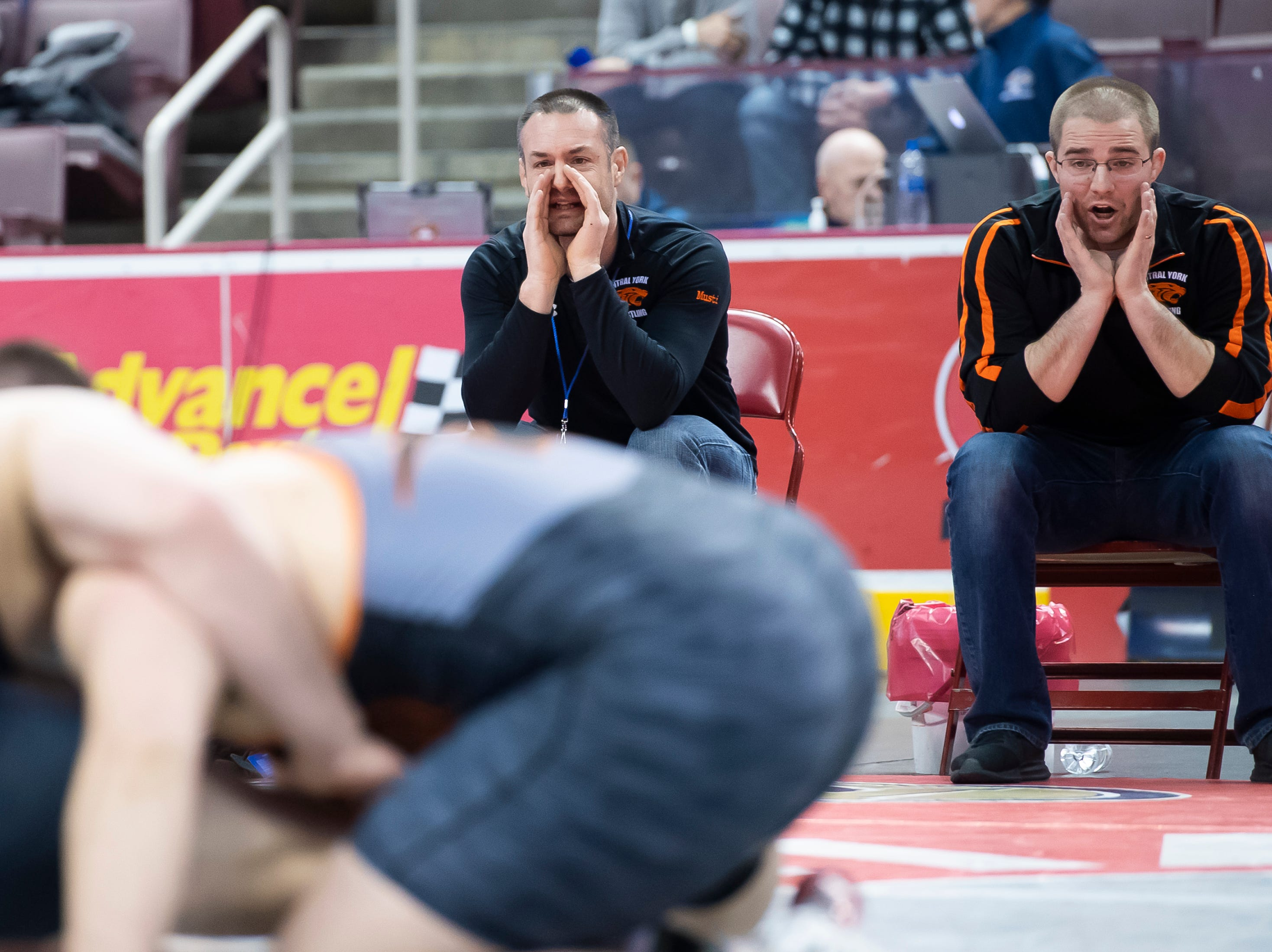 Central York coaches react as Michael Wolfgram wrestles Upper St. Clair's Jake Slinger during the 3A 285-pound semifinal bout at the Giant Center in Hershey Saturday, March 9, 2019. Slinger won by a 9-4 decision.