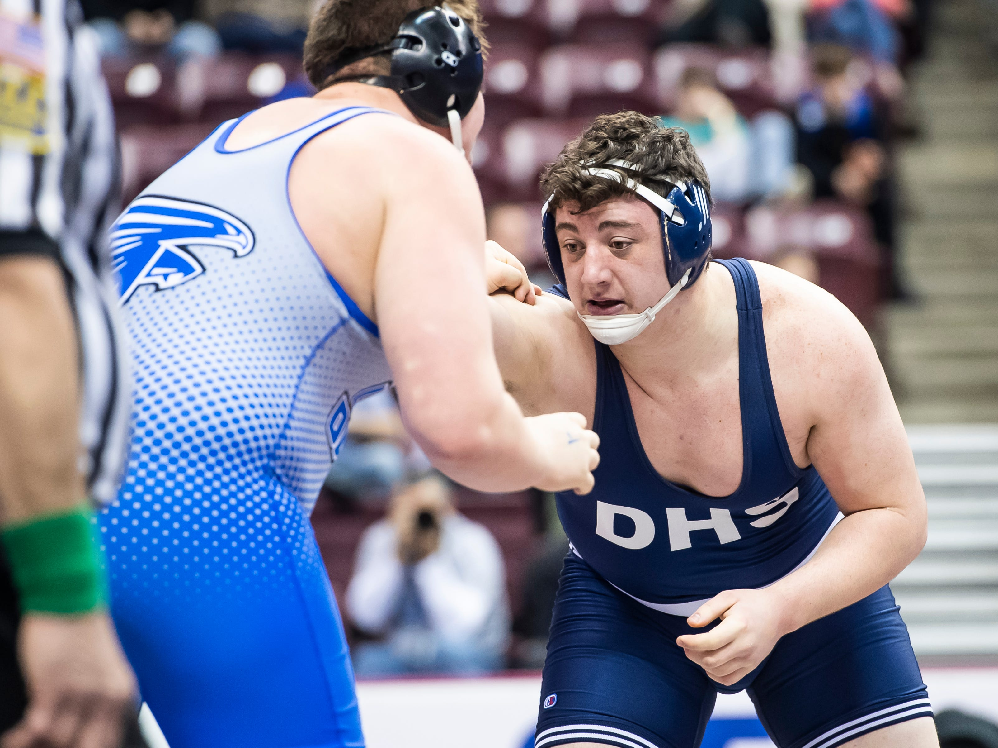 Dallastown's Raymond Christas, right, wrestles Lower Dauphin's Kyle Wuestner during a 3A 285-pound fourth round consolation bout at the Giant Center in Hershey Saturday, March 9, 2019. Christas won by a 6-3 decision.