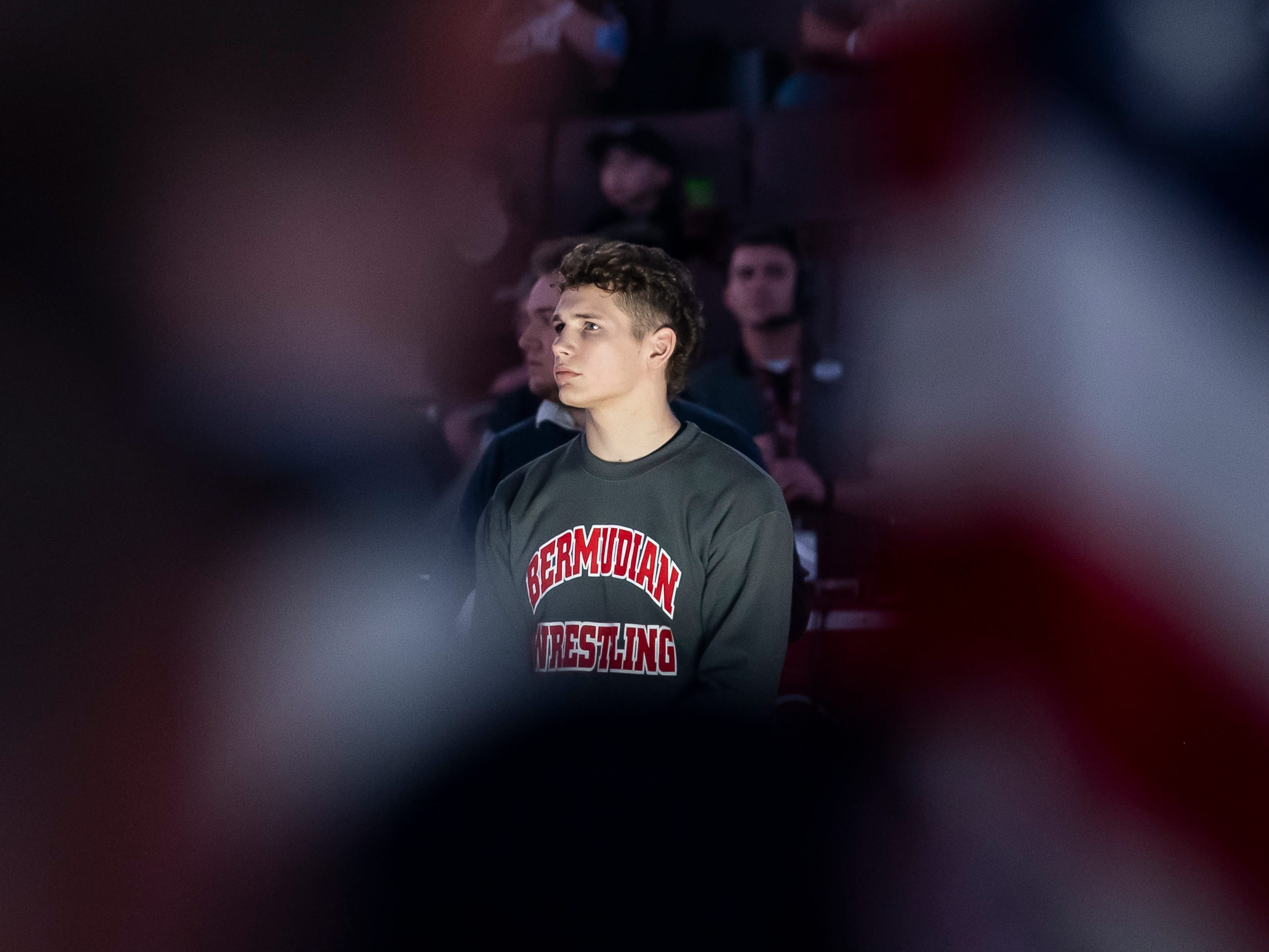 Bermudian Springs' Trenton Harder participates in the Parade of Champions prior to wrestling in the 2A 152-pound 5th-place bout at the PIAA championships in the Giant Center in Hershey Saturday, March 9, 2019.