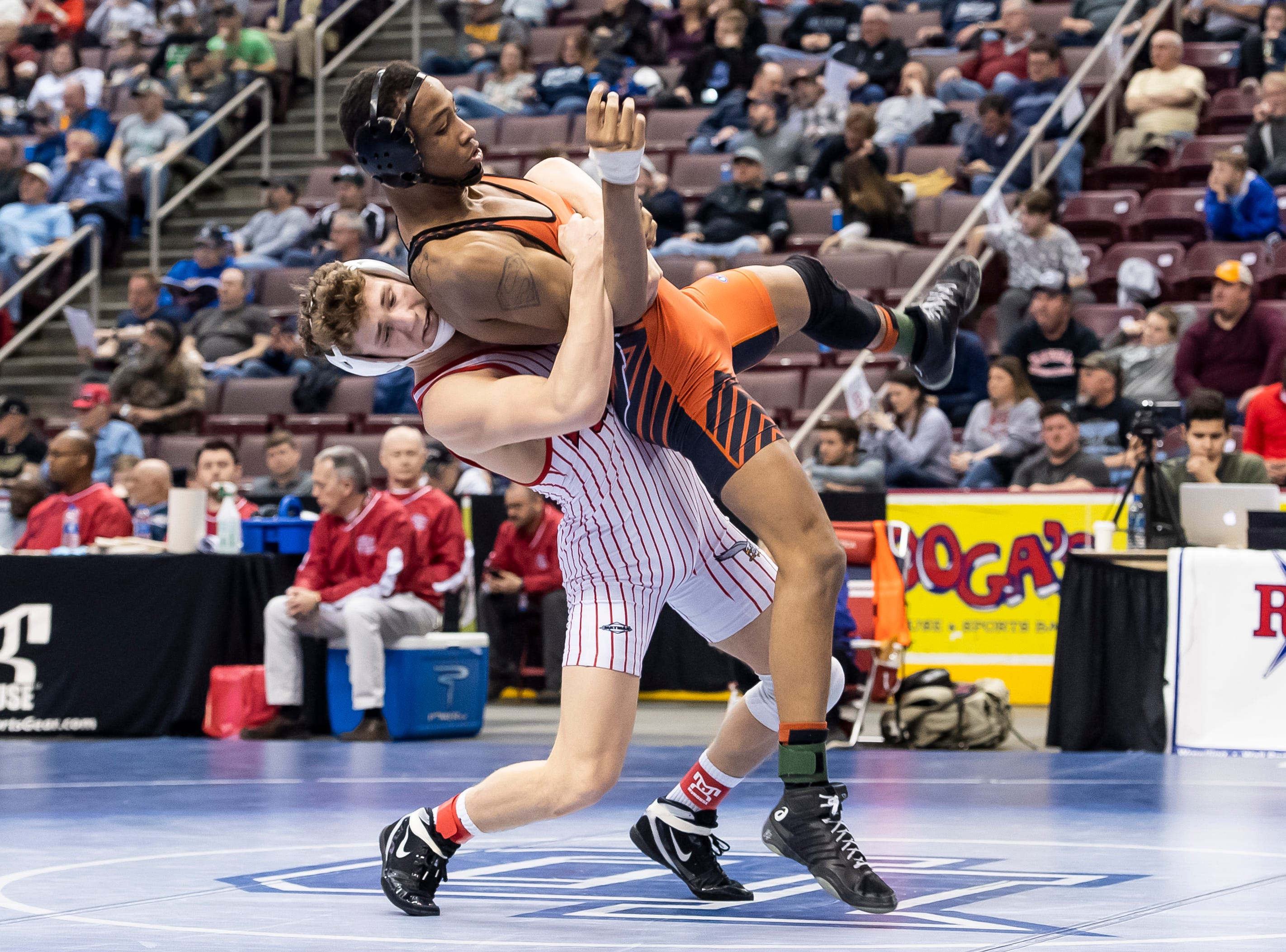 Bermudian Springs' Trenton Harder takes down Sharon's Sully Allen during the PIAA 2A 152-pound 5th-place bout at the Giant Center in Hershey Saturday, March 9, 2019. Allen won by fall 4:36.