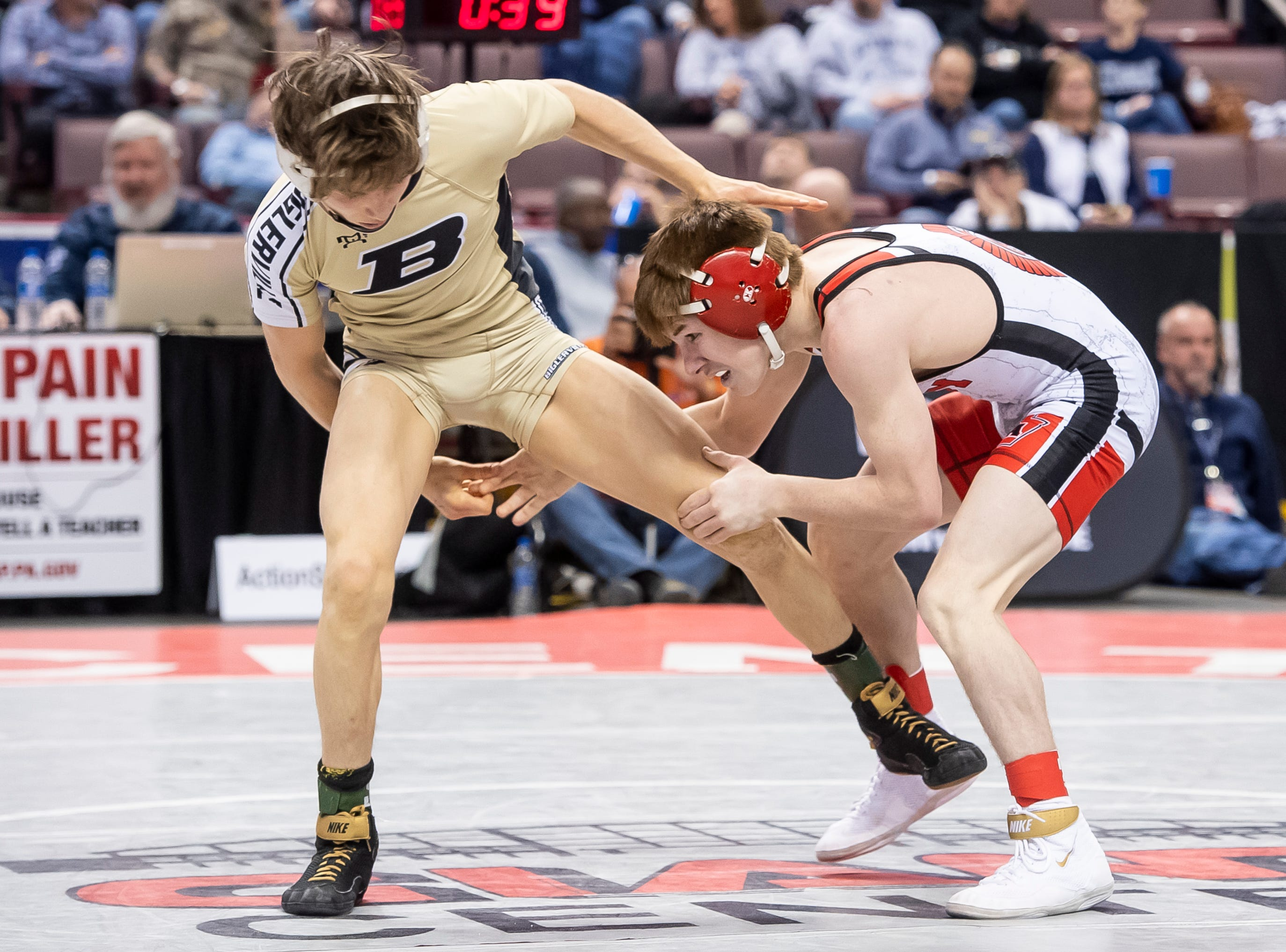 Biglerville's Levi Haines, left, wrestles Troy Area's Sheldon Seymour during the PIAA 2A 106-pound championship bout at the Giant Center in Hershey Saturday, March 9, 2019. Seymour won 5-4.