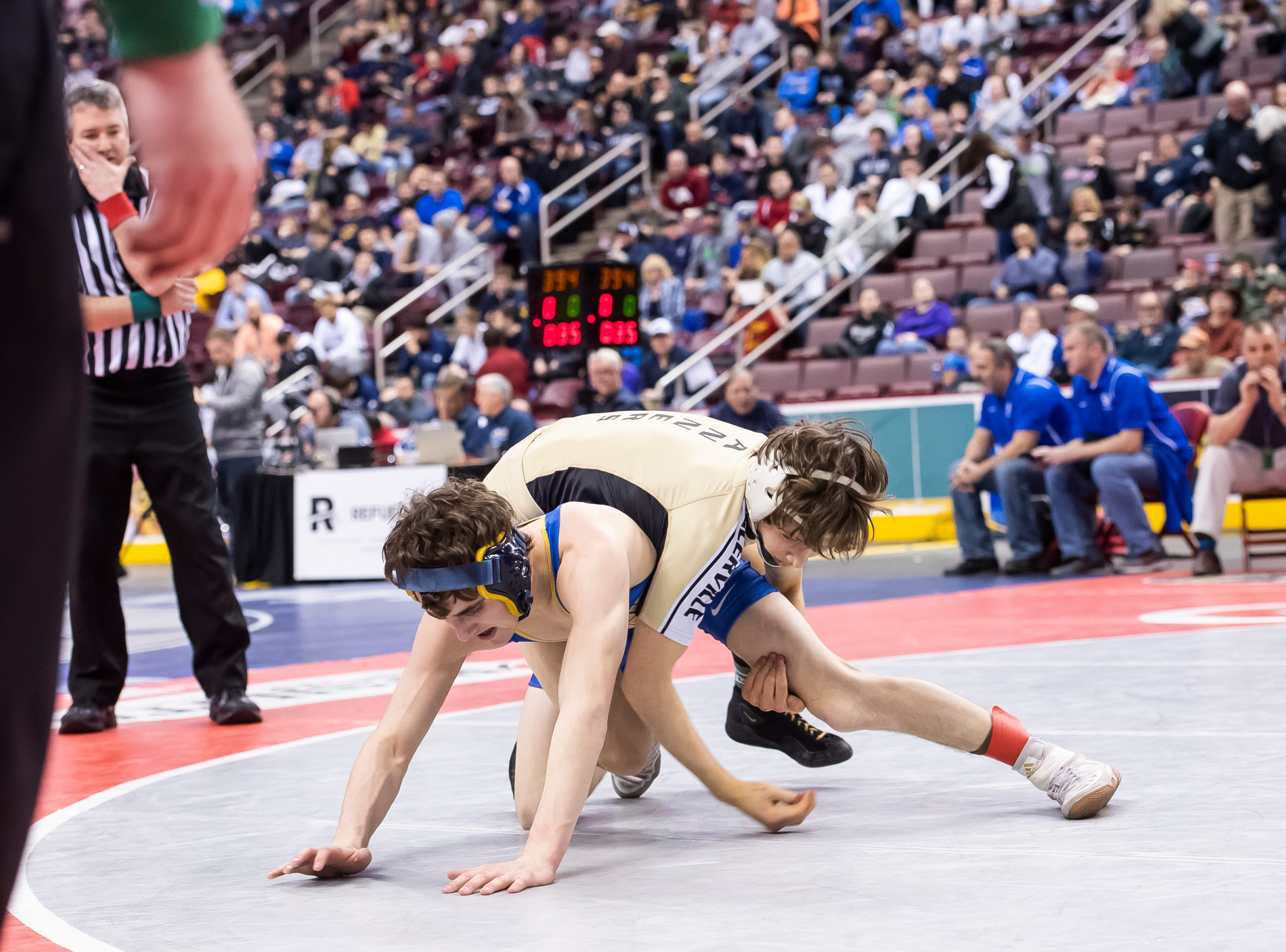 Biglerville's Levi Haines, top, wrestles Chestnut Ridge's Kai Burkett during the 2A 106-pound semifinal bout at the Giant Center in Hershey Friday, March 8, 2019. Haines won by major decision 8-0.