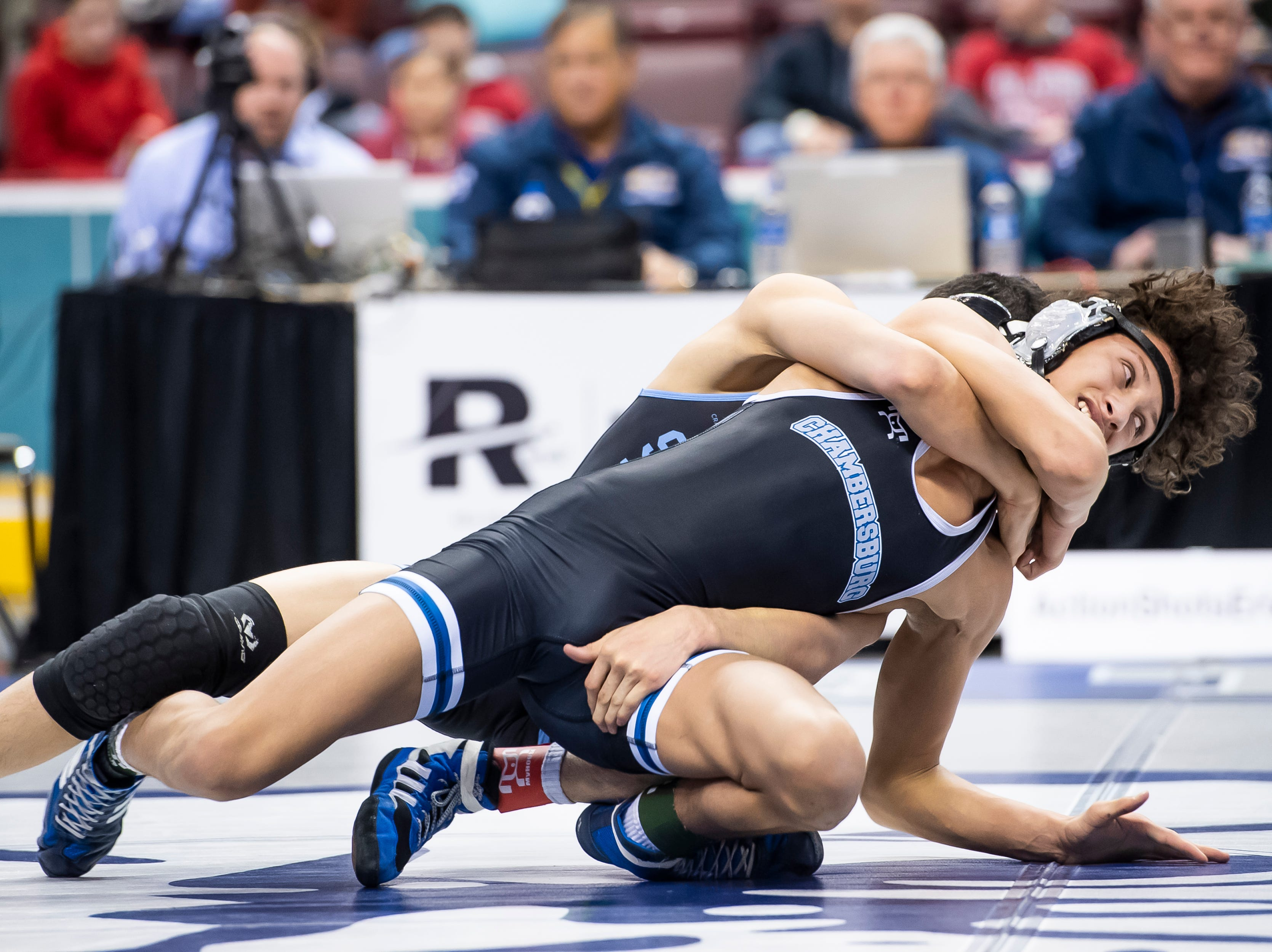 Chambersburg's Karl Schindledecker, front, wrestles Seneca Valley's Alejandro Herrera during a 3A 113-pound fourth round consolation bout at the Giant Center in Hershey Saturday, March 9, 2019. Herrera won by a 6-0 decision.