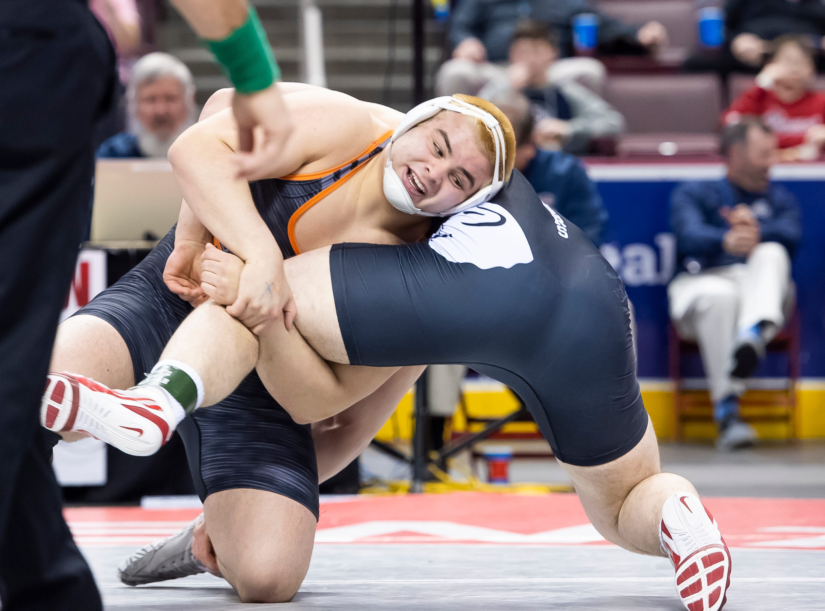 Central York's Michael Wolfgram, top, wrestles Upper St. Clair's Jake Slinger during the 3A 285-pound semifinal bout at the Giant Center in Hershey Saturday, March 9, 2019. Slinger won by a 9-4 decision.