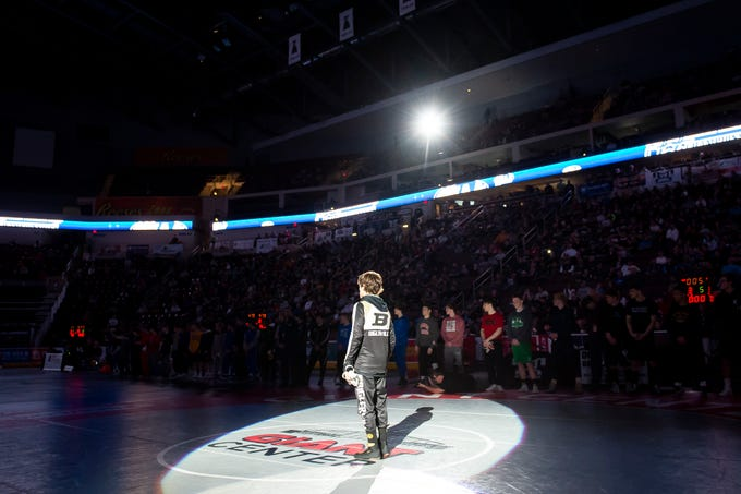 Biglerville's Levi Haines is introduced in the Parade of Champions prior to wrestling in the 2A 106-pound PIAA championship bout at the Giant Center in Hershey Saturday, March 9, 2019.