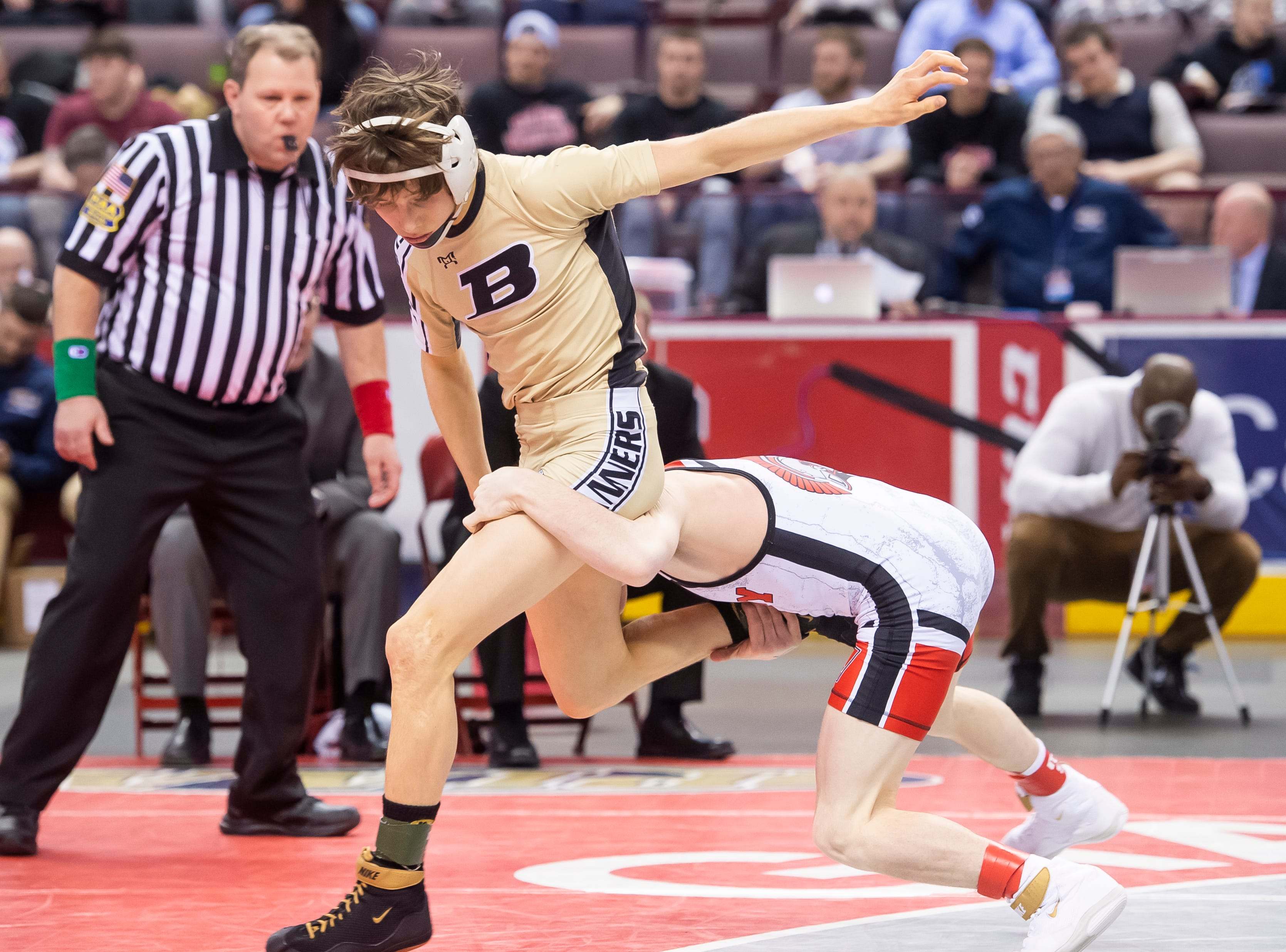 Biglerville's Levi Haines, left, wrestles Troy Area's Sheldon Seymour during the PIAA 2A 106-pound championship bout at the Giant Center in Hershey Saturday, March 9, 2019. Seymour won with a 5-4 decision.