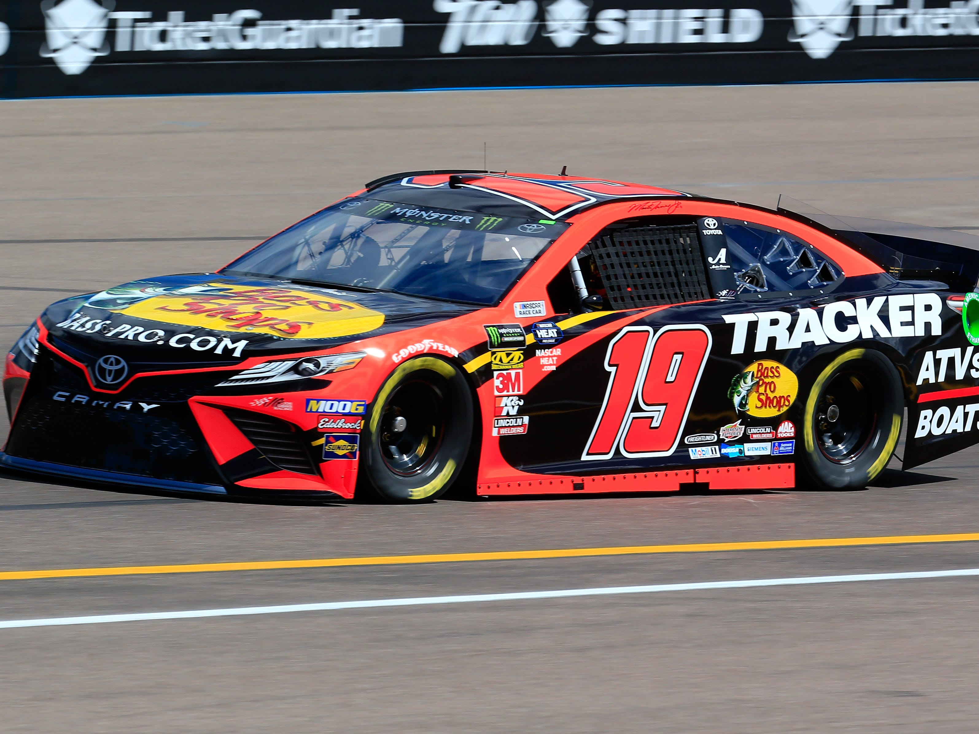 AVONDALE, AZ - MARCH 08: Martin Truex Jr., driver of the #19 Bass Pro Shops Toyota, practices for the Monster Energy NASCAR Cup Series TicketGuardian 500 at ISM Raceway on March 8, 2019 in Avondale, Arizona.