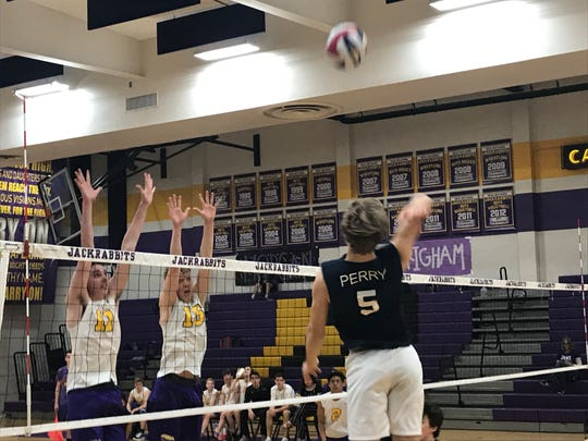 Gilbert Perry outside hitter Dalan Smith jumps for the kill against Mesa on March 5, 2019.