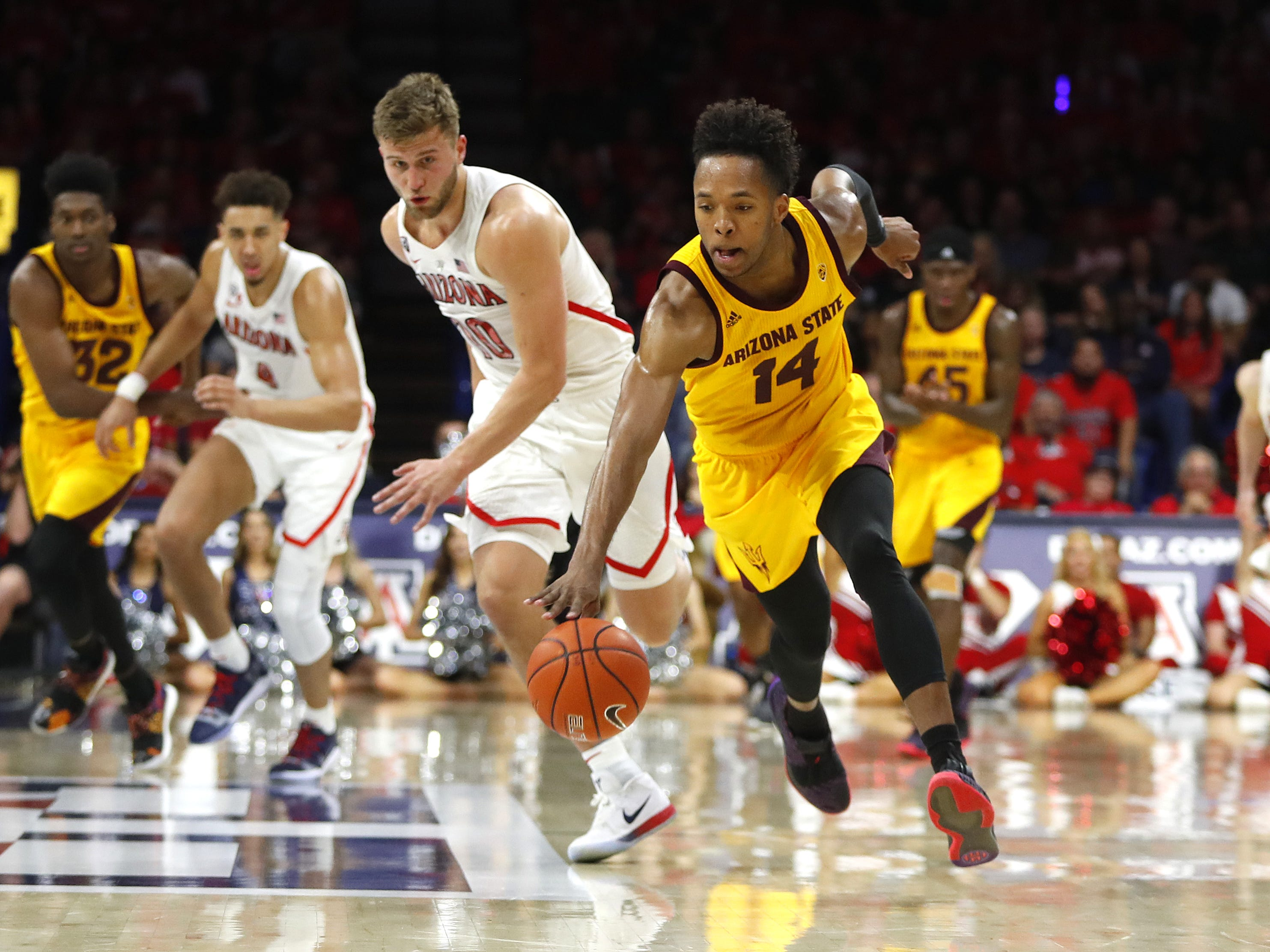 ASU's Kimani Lawrence (14) recovers a steal from Arizona's Ryan Luther (10) during the second half at the McKale Memorial Center in Tucson, Ariz. on March 9, 2019.