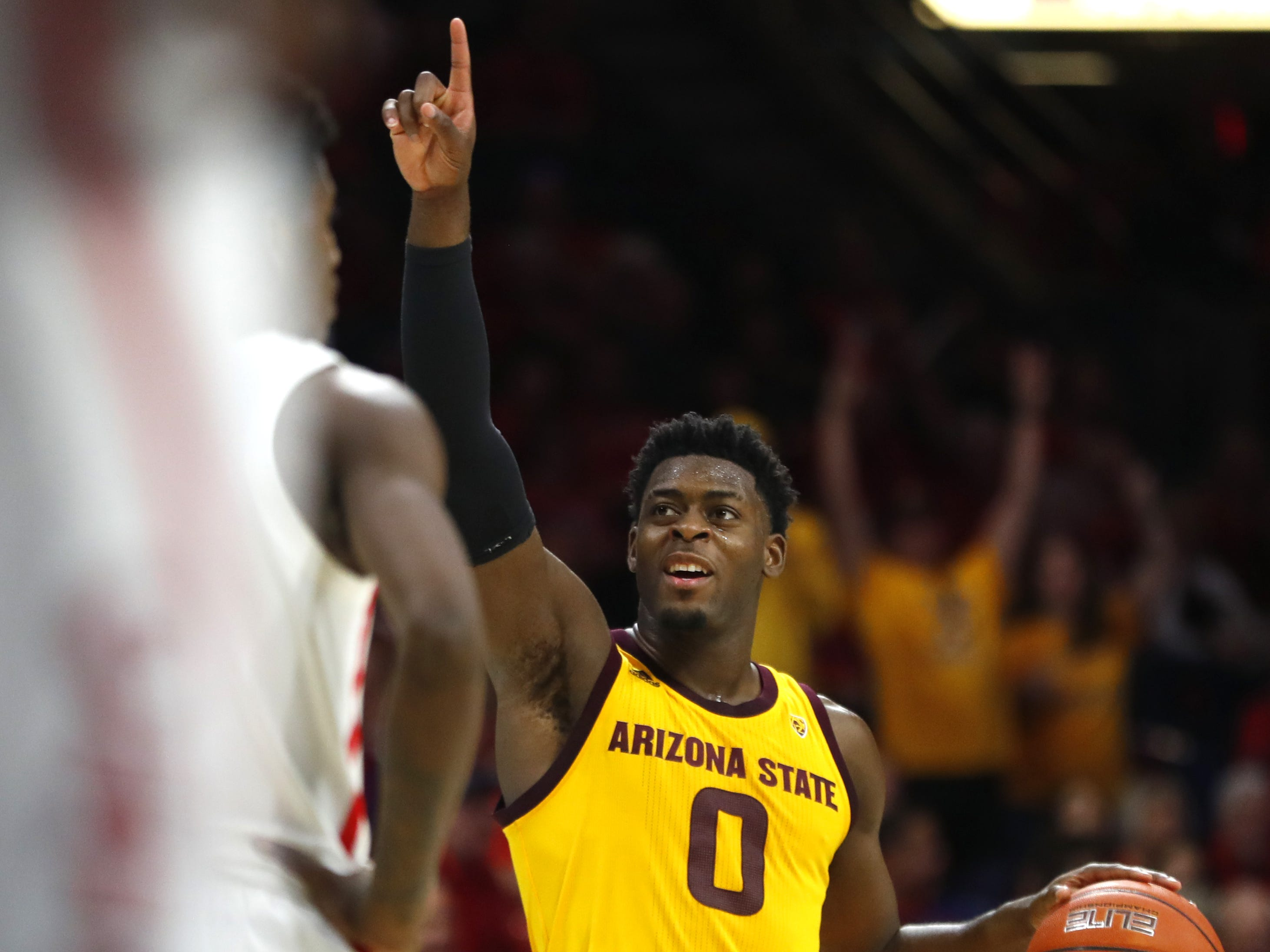ASU's Luguentz Dort (0) celebrates as he dribbles out the clock as ASU beat Arizona 72-64 at the McKale Memorial Center in Tucson, Ariz. on March 9, 2019.