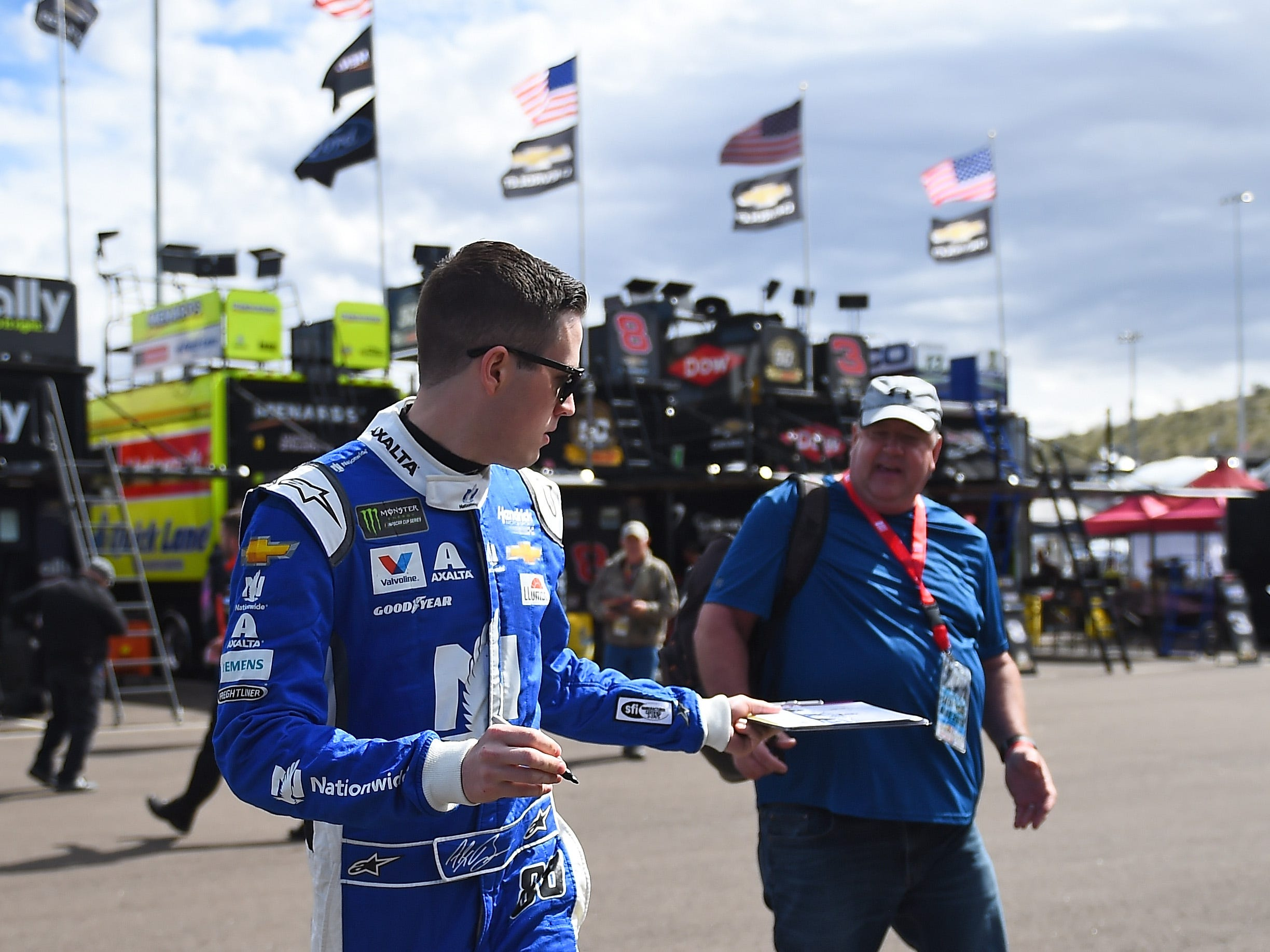 AVONDALE, AZ - MARCH 08:  Alex Bowman, driver of the #88 Nationwide Chevrolet, walks to his car during practice for the Monster Energy NASCAR Cup Series TicketGuardian 500 at ISM Raceway on March 8, 2019 in Avondale, Arizona.