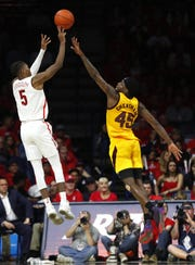 Arizona's Brandon Randolph (5) shoots against ASU's Luguentz Dort (0) during the second half at the McKale Memorial Center in Tucson, Ariz. on March 9, 2019.