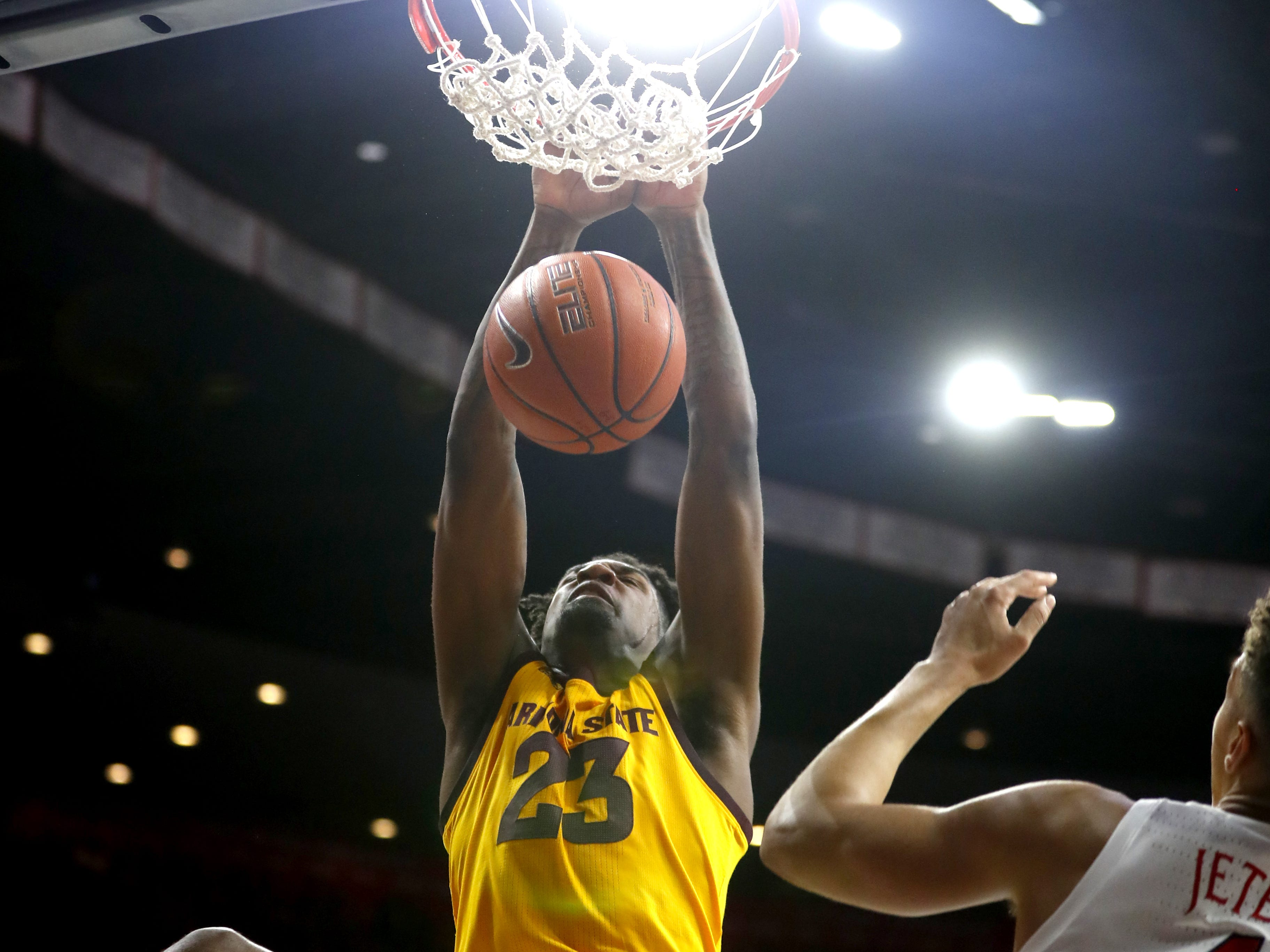 ASU's Romello White (23) dunks against Arizona's Chase Jeter (4) during the second half at the McKale Memorial Center in Tucson, Ariz. on March 9, 2019.