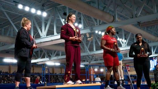 Samantha Noennig is crowned NCAA shot put champion in Ala., on Friday.