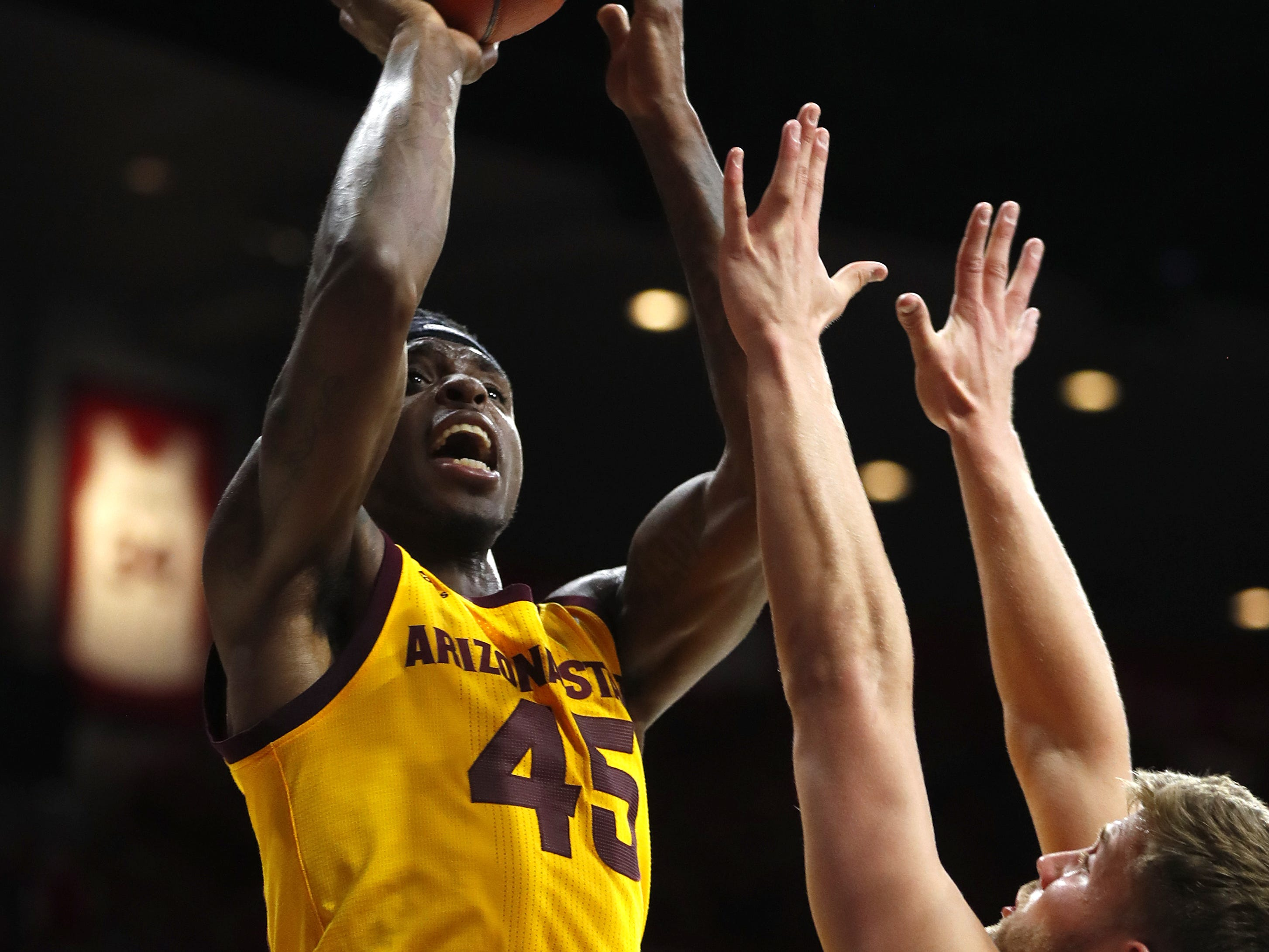 ASU's Zylan Cheatham (45) shoots over Arizona's Ryan Luther (10) during the second half at the McKale Memorial Center in Tucson, Ariz. on March 9, 2019.