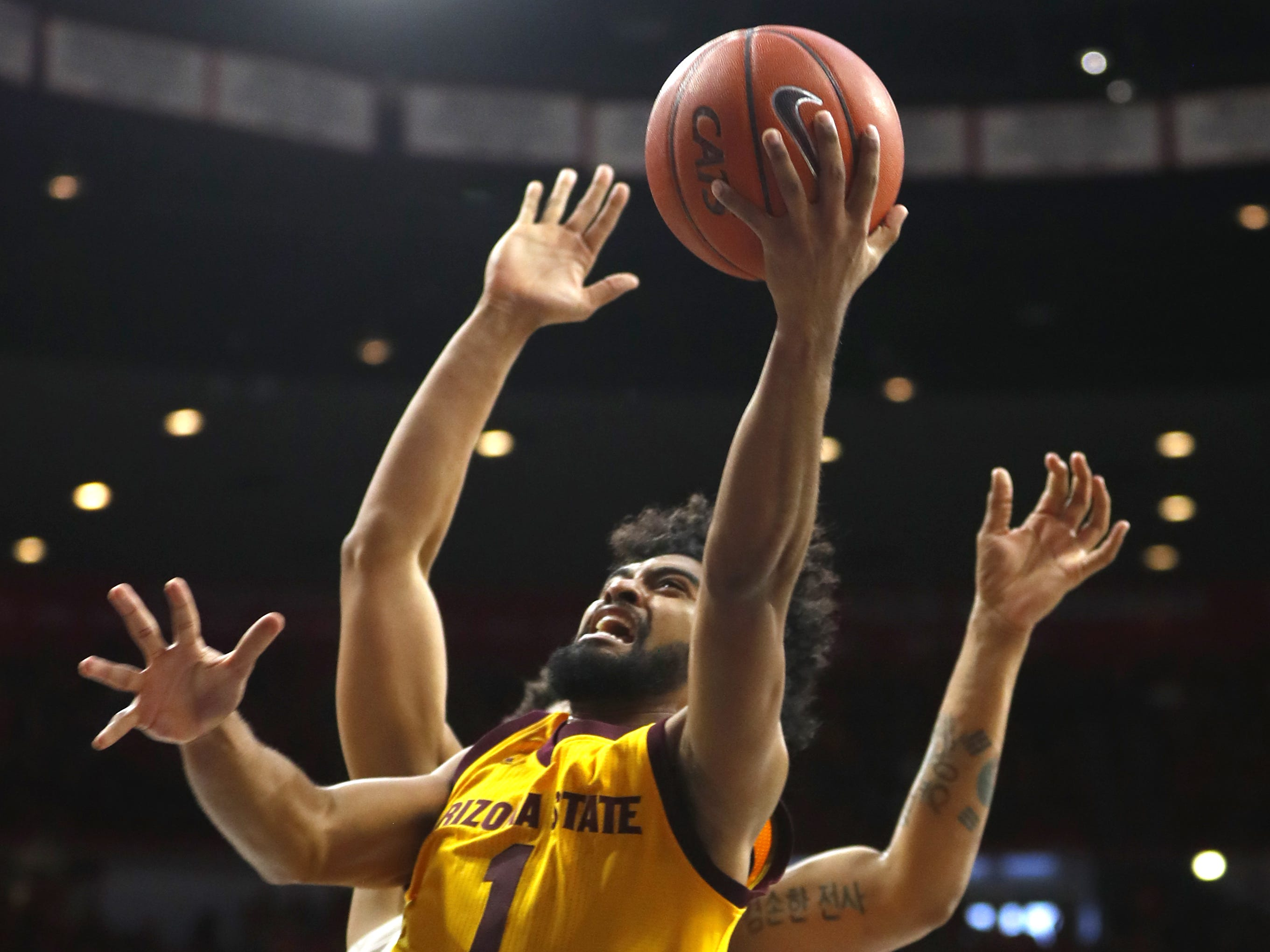 ASU's Remy Martin (1) makes a layup against Arizona during the second half at the McKale Memorial Center in Tucson, Ariz. on March 9, 2019.