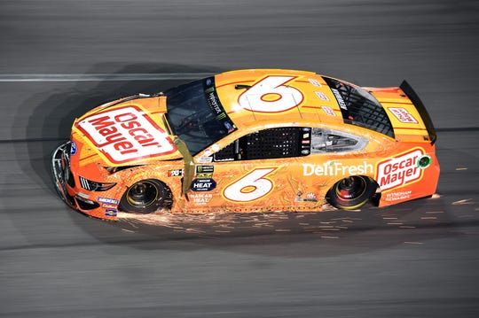 Feb 17, 2019: NASCAR Cup Series driver Ryan Newman (6) scrapes the track as he limps into turn four trying to reach the garage area after getting wrecked during the Daytona 500 at Daytona International Speedway.