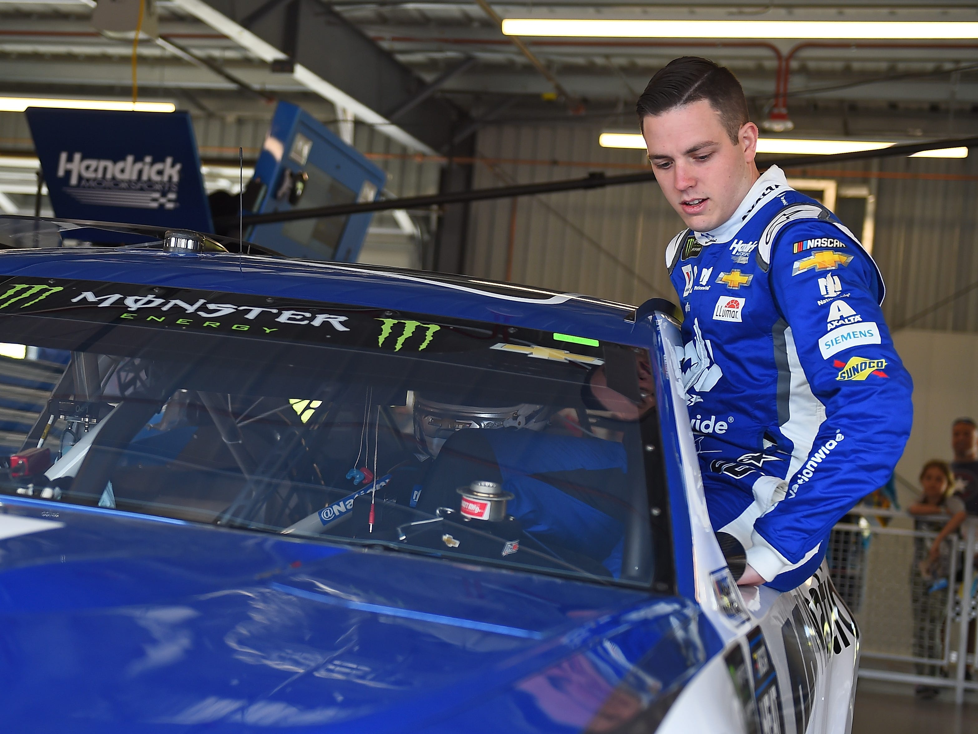AVONDALE, AZ - MARCH 08:  Alex Bowman, driver of the #88 Nationwide Chevrolet, gets into his car during practice for the Monster Energy NASCAR Cup Series TicketGuardian 500 at ISM Raceway on March 8, 2019 in Avondale, Arizona.