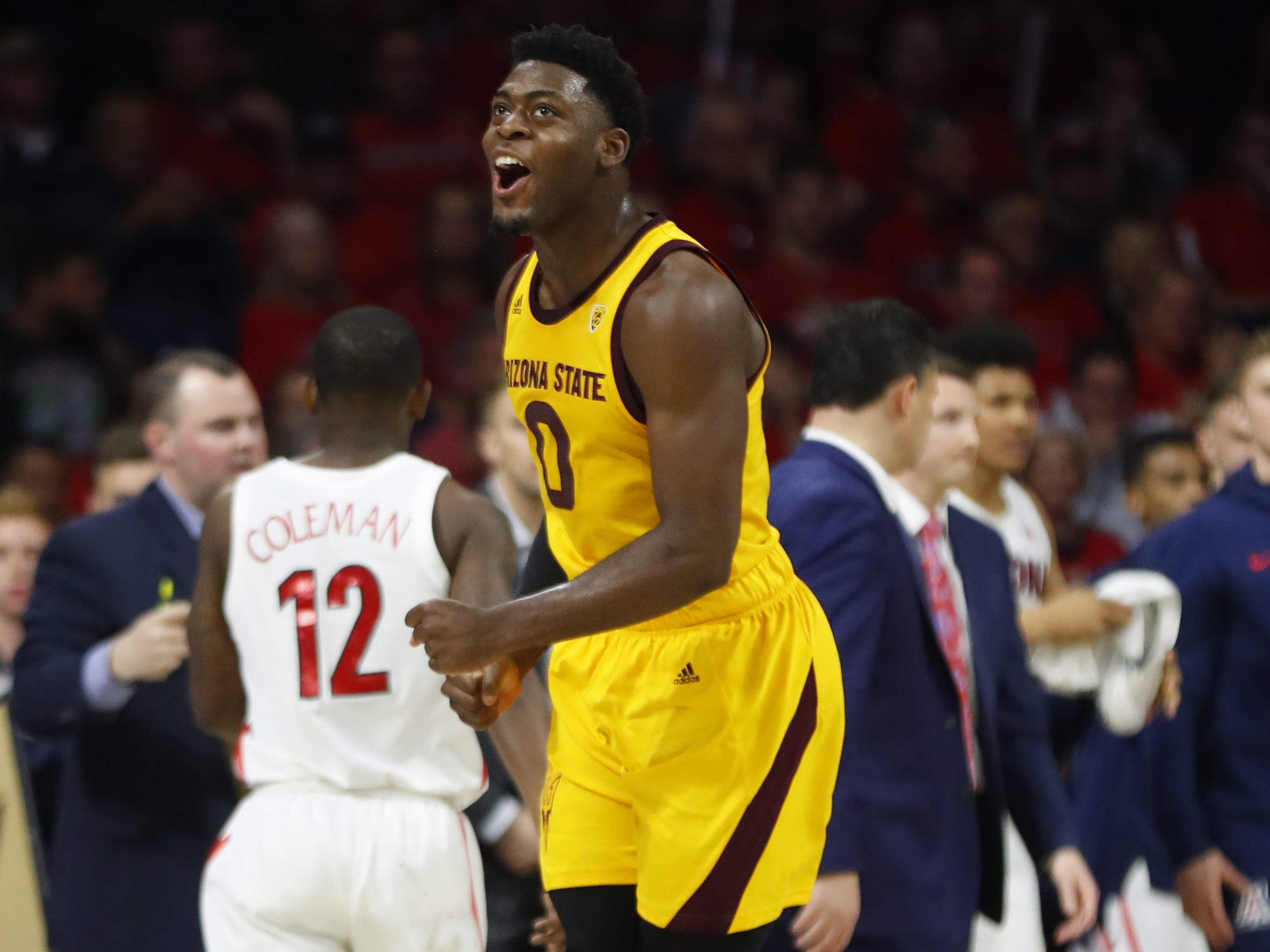 ASU's Luguentz Dort (0) celebrates a dunk against Arizona during the second half at the McKale Memorial Center in Tucson, Ariz. on March 9, 2019.