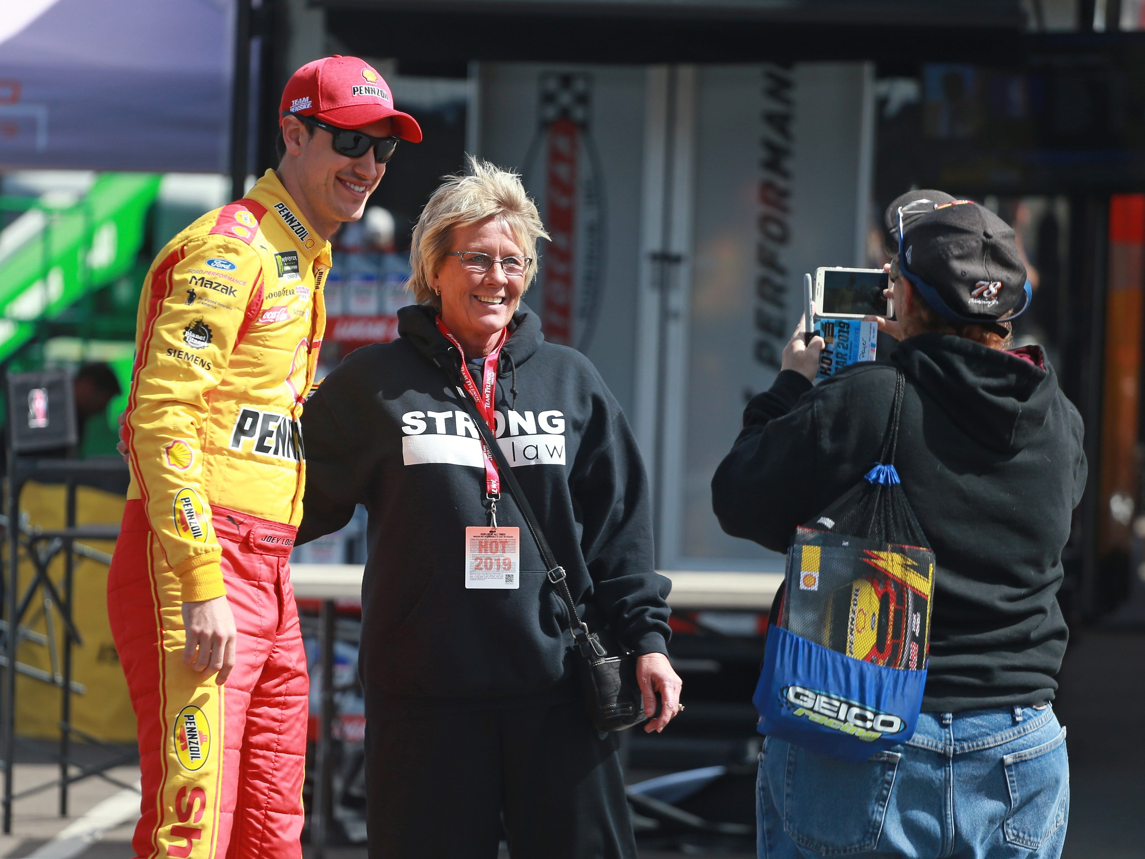 AVONDALE, AZ - MARCH 08:  Joey Logano, driver of the #22 Shell Pennzoil Ford, takes a photo during practice for the Monster Energy NASCAR Cup Series TicketGuardian 500 at ISM Raceway on March 8, 2019 in Avondale, Arizona.
