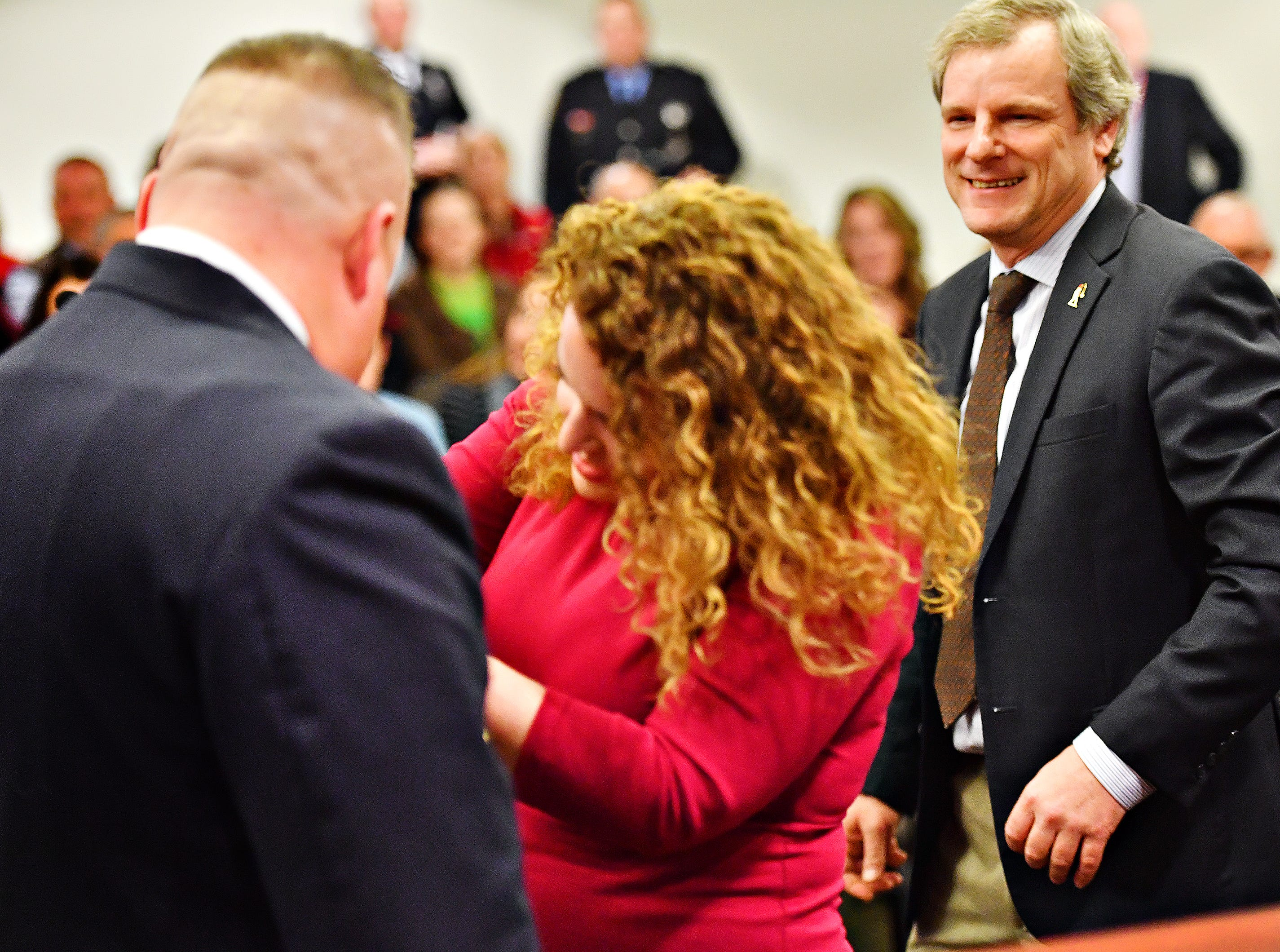 From right, York City Mayor Michael Helfrich looks on as Jess Deardorff pins her husband, York City Fire Chief Chad Deardorff during his swearing-in ceremony at York City Hall in York City, Friday, March 8, 2019. Dawn J. Sagert photo