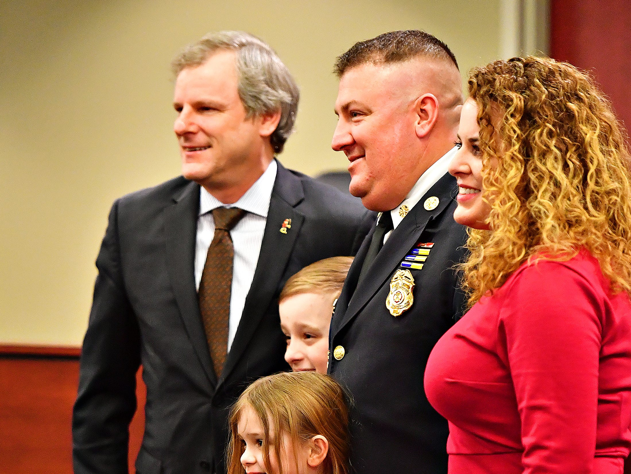 Clockwise from left, York City Mayor Michael Helfrich poses for a photo with York City Fire Chief Chad Deardorff's wife, Jess daughter Sophia, 7, and son Adam, 9, during Deardorff's swearing-in ceremony at York City Hall in York City, Friday, March 8, 2019. Dawn J. Sagert photo