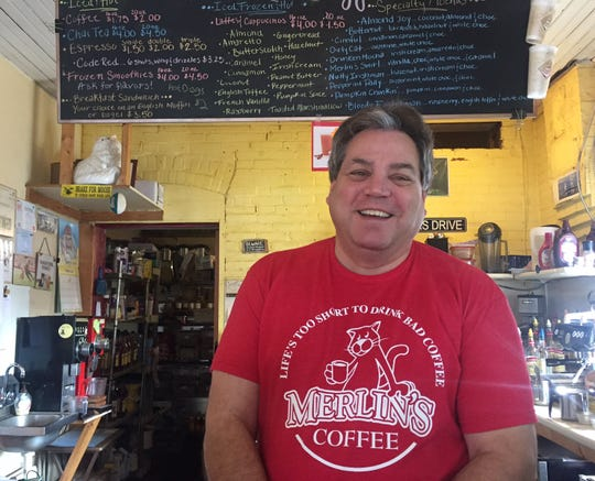 """Eric Burns, owner of Merlin's Coffee & Tea in Hanover, said flyers attacking the borough's mayor are """"archaic"""" (Photo by Rebecca Klar)."""