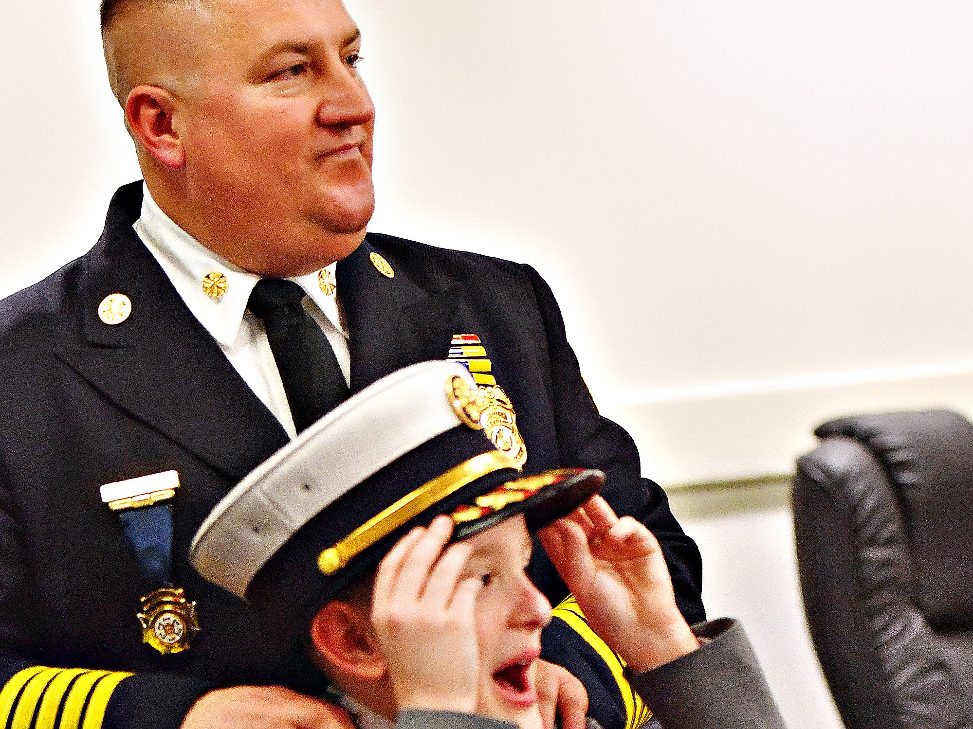 York City Fire Chief Chad Deardorff with his son Adam, 9, following his swearing-in ceremony at York City Hall in York City, Friday, March 8, 2019. Dawn J. Sagert photo