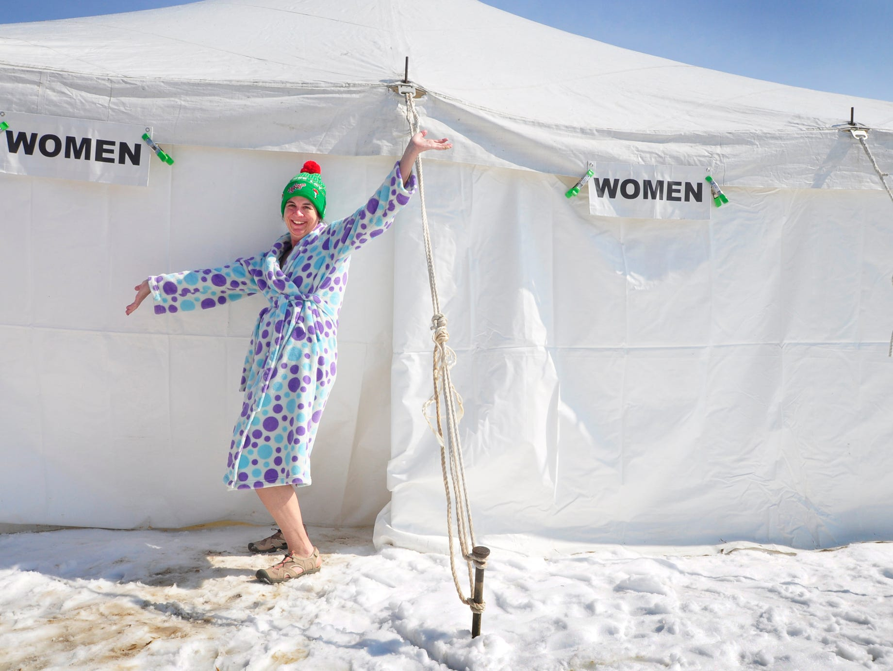 Traci LaMendola of Glenville models her finest bathrobe upon exiting the changing tent. Law Enforcement for Special Olympics PA Polar Plunge was Saturday at noon at the Wrightsville House with people hitting the 34-degree water to raise money for Special Olympics.