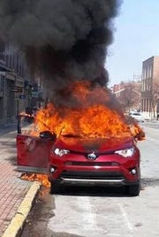 Residents helped rescue a man from a burning car on the corner of Market Street and George Street in York City on Saturday March 9, according to the fire department (Photo courtesy of the York City Fire Department).