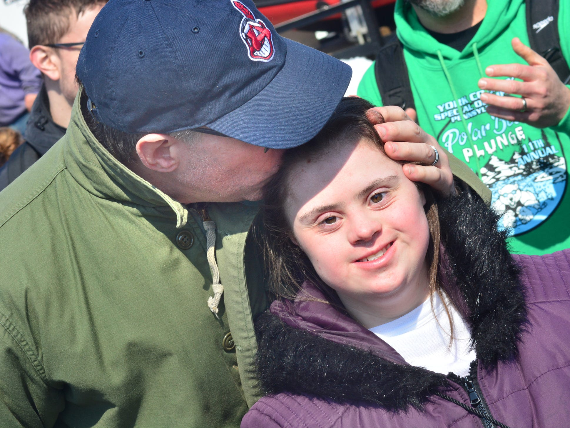 Ed Mundorf of New Salem gives his daughter Alexis a kiss prior to her leading a wave of plungers into the water. Law Enforcement for Special Olympics PA Polar Plunge was Saturday at noon at the Wrightsville House with people hitting the 34-degree water to raise money for Special Olympics.