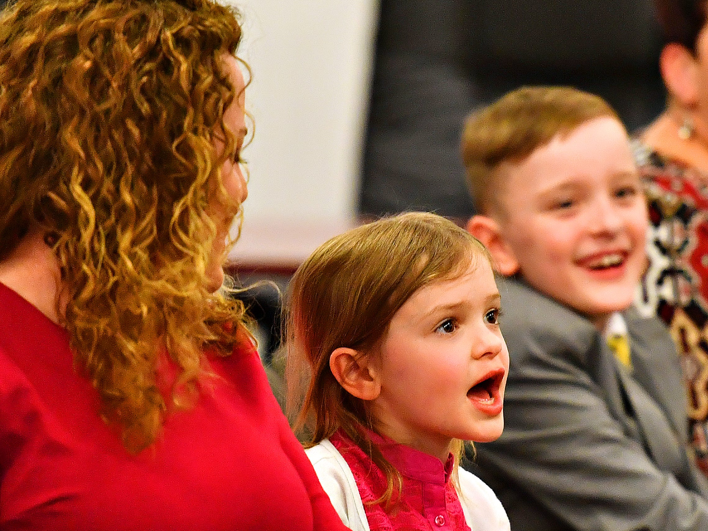 "Sophia Deardorff, 7, second from left front, announces, ""I hope he doesn't grow a mustache like Chief Michaels,"" referring to her father, the newly sworn-in York City Fire & Rescue Fire Chief Chad Deardorff, following the ceremony at York City Hall in York City, Friday, March 8, 2019. Dawn J. Sagert photo"