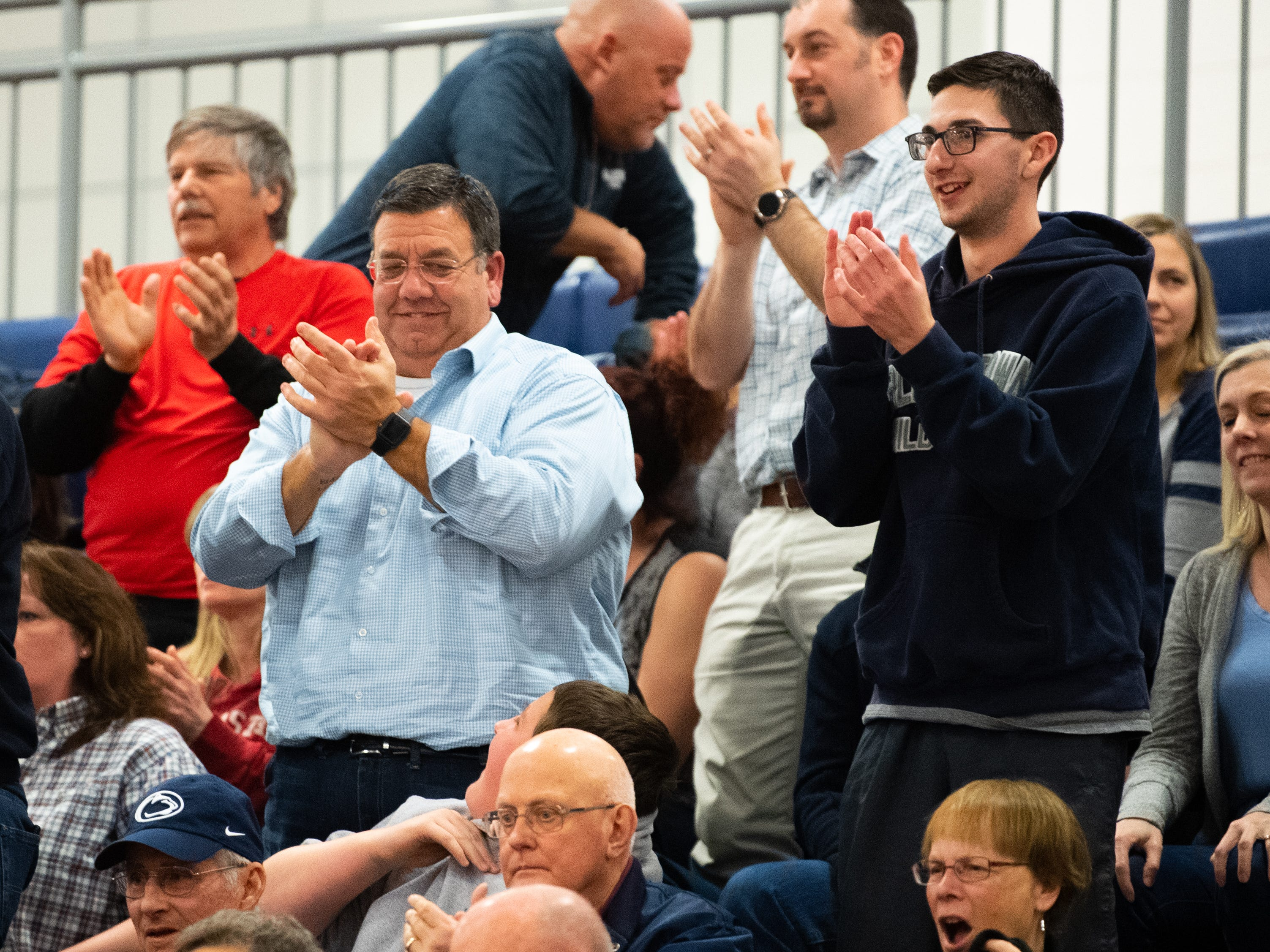 Dallastown fans give their team a standing ovation after the game, March 8, 2019 at West York Area High School. The Wildcats defeated the Cougars 43 to 39.