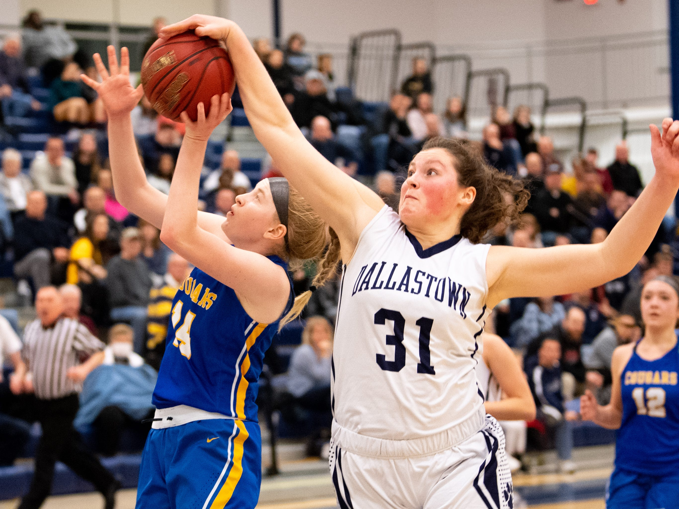 Samantha Miller (31) gets a block during the PIAA first round girls' basketball game between Dallastown and Downingtown East Friday, March 8, 2019 at West York Area High School. The Wildcats are neck and neck with the Cougars.