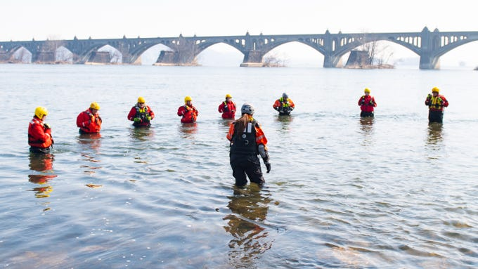 River rescue workers make sure the plunge is safe for everyone during the 2019 Polar Plunge, Saturday, March 9, 2019.