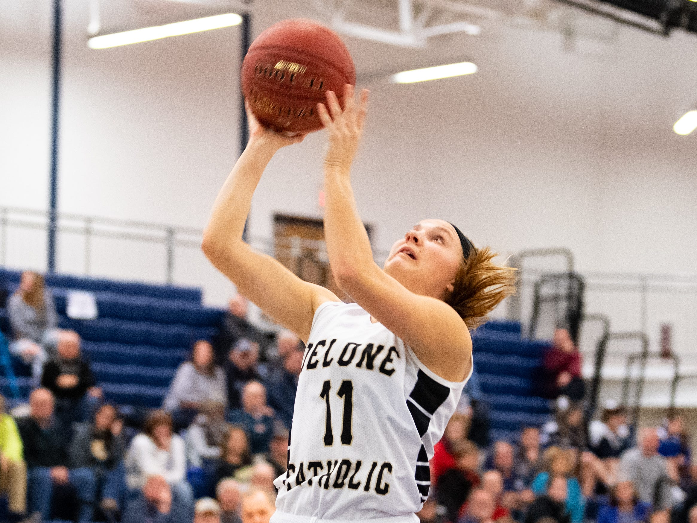 Riley Vingsen (11) lays the ball up during the PIAA first round girls' basketball game between Delone Catholic and Lewisburg Area Friday, March 8, 2019 at West York Area High School. The Squires lead the Green Dragons.