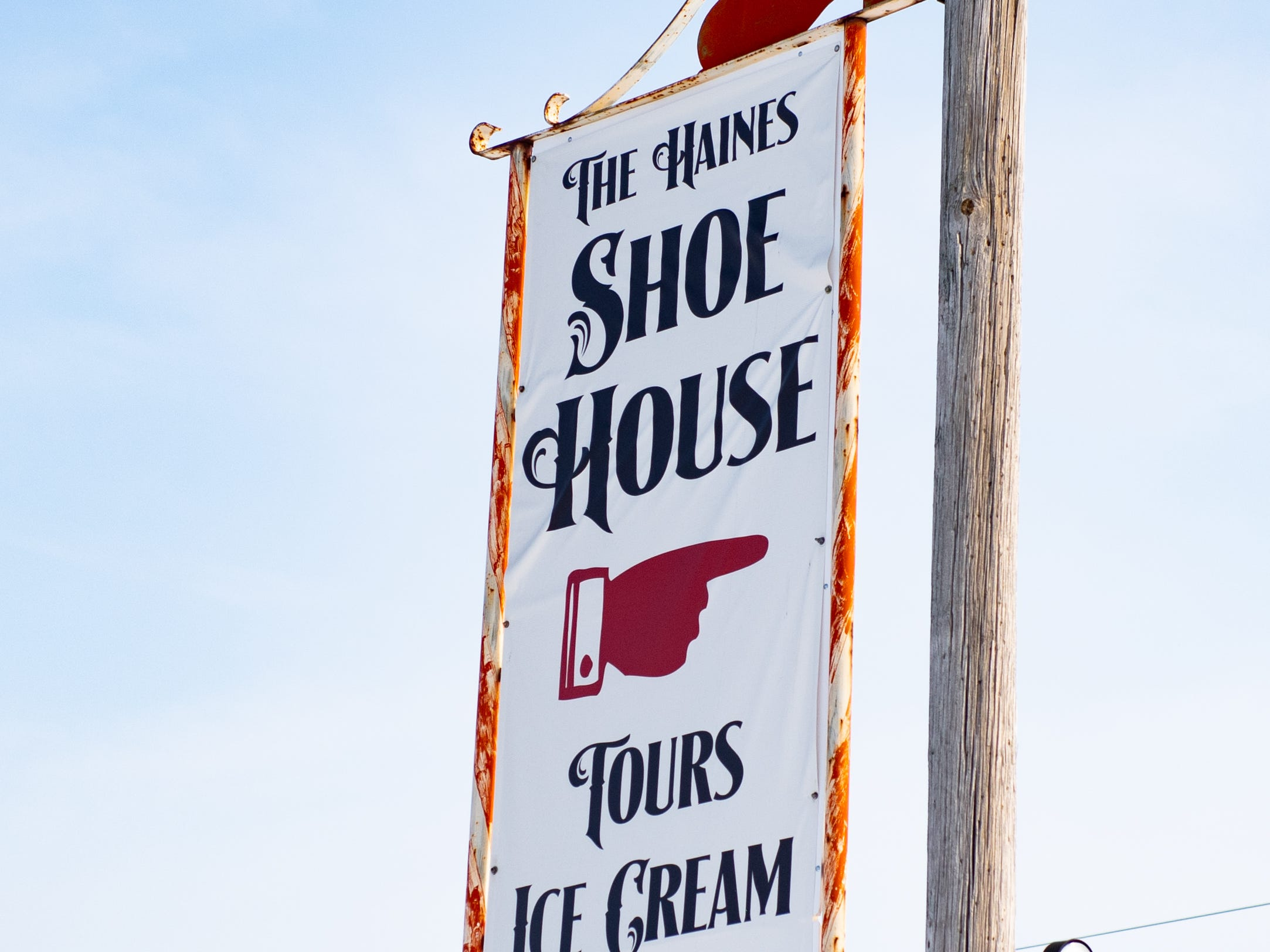 "The sign and shoe house still stands tall, but will never be the same without Melanie ""Mel"" Schmuck."