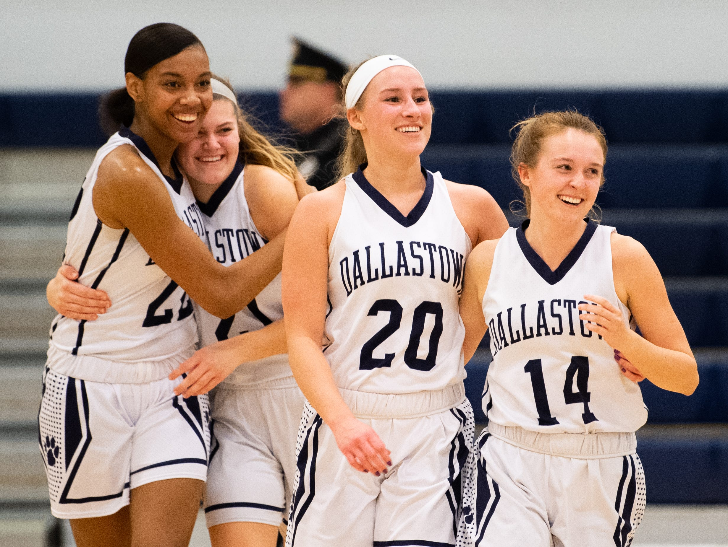 Dallastown celebrates their narrow win over Downingtown East after the PIAA first round girls' basketball game Friday, March 8, 2019 at West York Area High School. The Wildcats defeated the Cougars 43 to 39.
