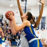 The Dallastown girls' basketball team defeated Downingtown East, 43-39, in the PIAA Class 6A playoffs Friday. The Cougars feature 6-foot-5 Division I recruit Bella Smuda.