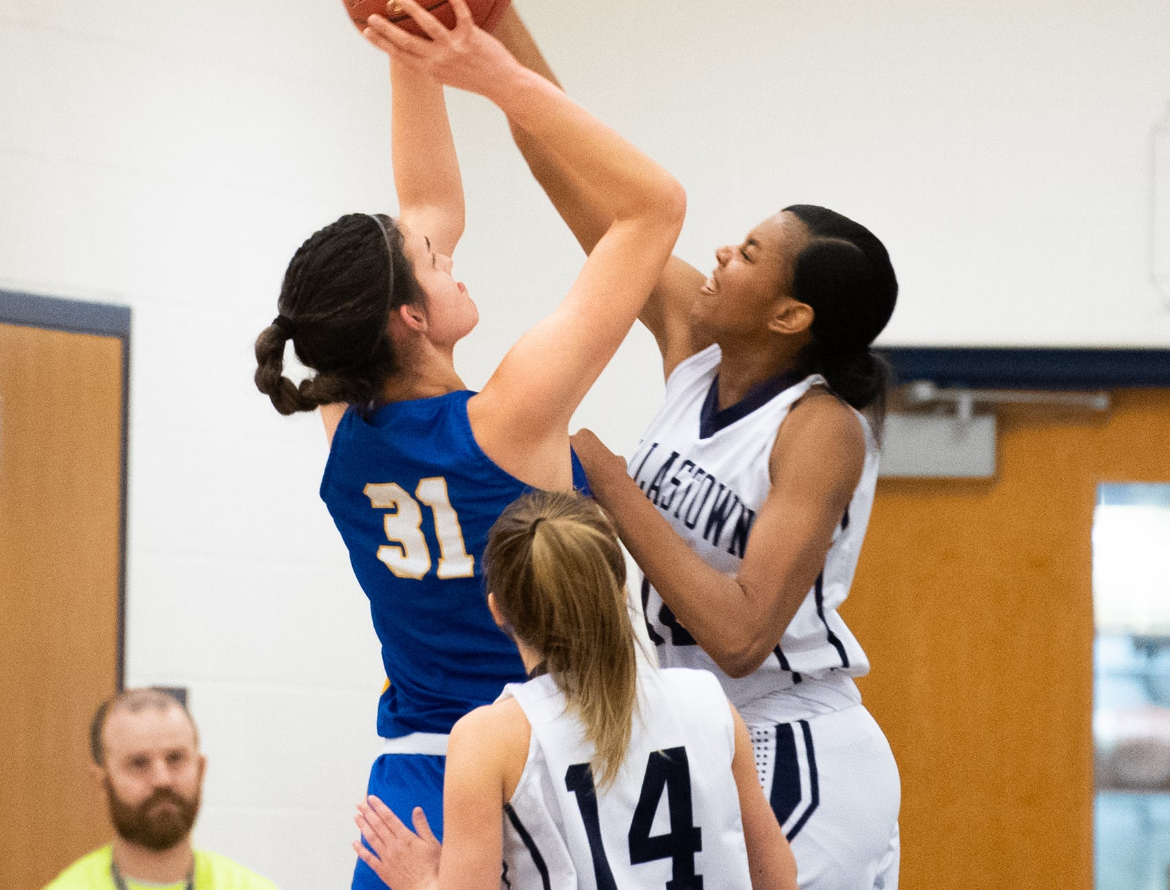 Bella Smuda (31) dodges Aniya Matthews' (22) block during the PIAA first round girls' basketball game between Dallastown and Downingtown East Friday, March 8, 2019 at West York Area High School. The Wildcats defeated the Cougars 43 to 39.