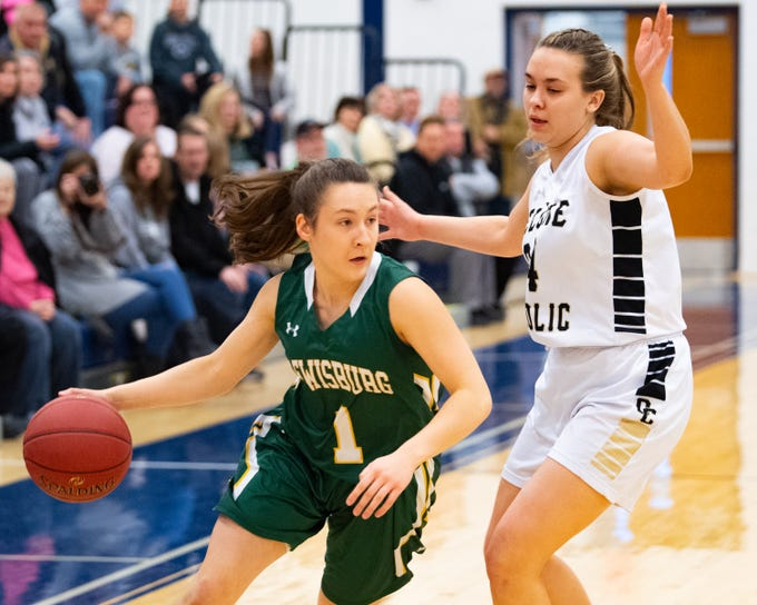 Grace Kelleher (1) looks to drive base line during the PIAA first round girls' basketball game between Delone Catholic and Lewisburg Area Friday, March 8, 2019 at West York Area High School. The Squires lead the Green Dragons.