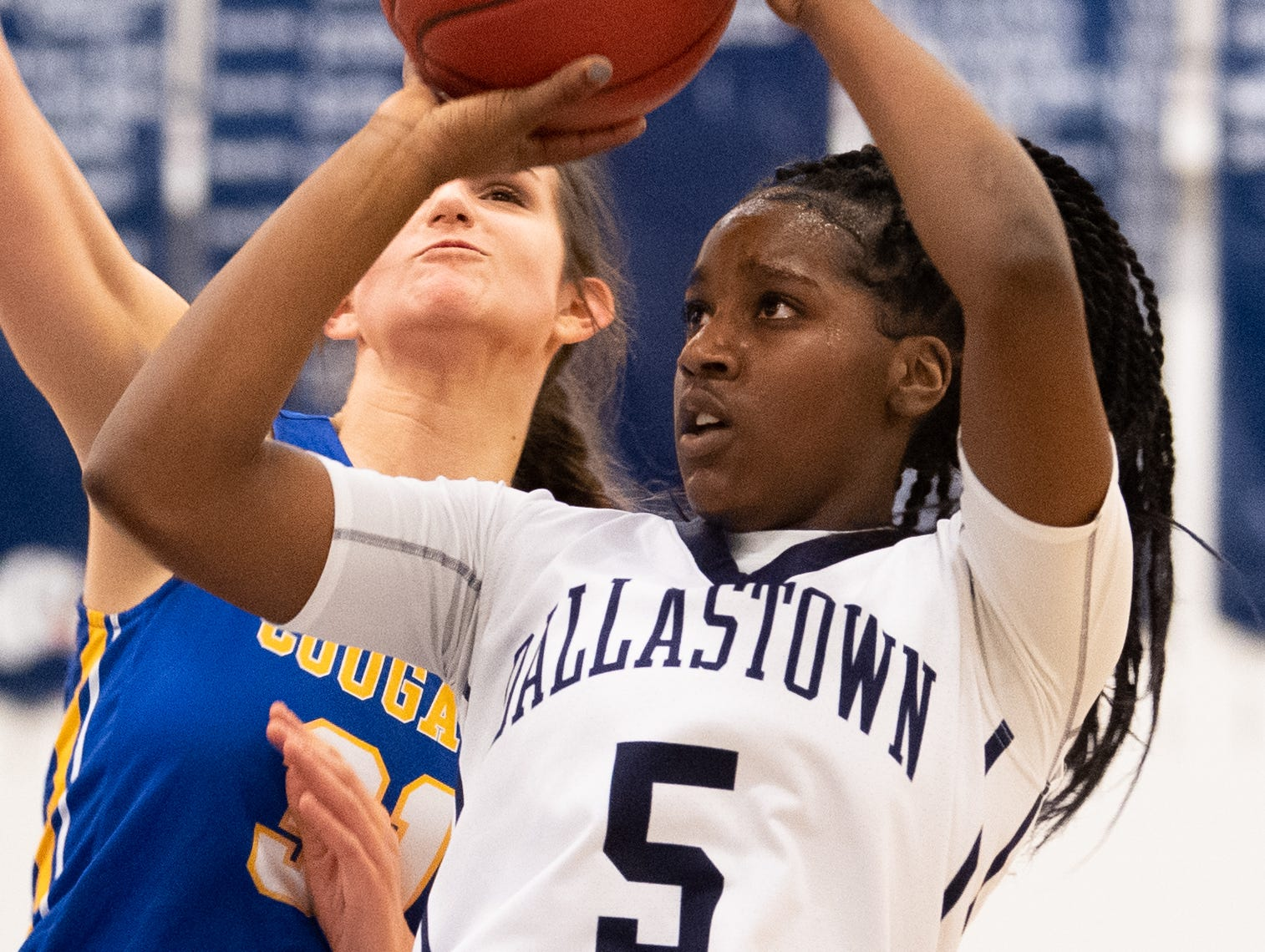 D'Shante Edwards (5) takes the shot during the PIAA first round girls' basketball game between Dallastown and Downingtown East Friday, March 8, 2019 at West York Area High School. The Wildcats are neck and neck with the Cougars.