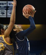 Nevada's Jade Redmon shoots with Wyoming's Bailee Cotton behind her  at Lawlor Events Center on Feb. 16.