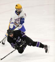 John Jay's Mattie Wierl goes to the ice trying to control the puck against Queensbury in NYS semifinal game.