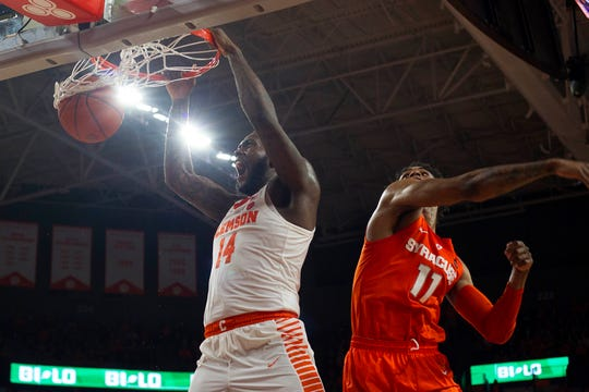 Clemson Tigers forward Elijah Thomas (14) dunks the ball while being defended by Syracuse Orange forward Oshae Brissett (11) during the Tigers 67-55 win Saturday at Littlejohn Coliseum.